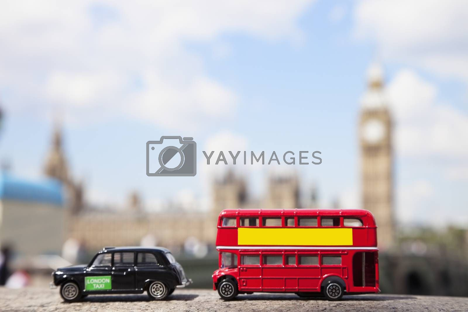Royalty free image of Public transport figurines with Big Ben Tower in the background by moodboard