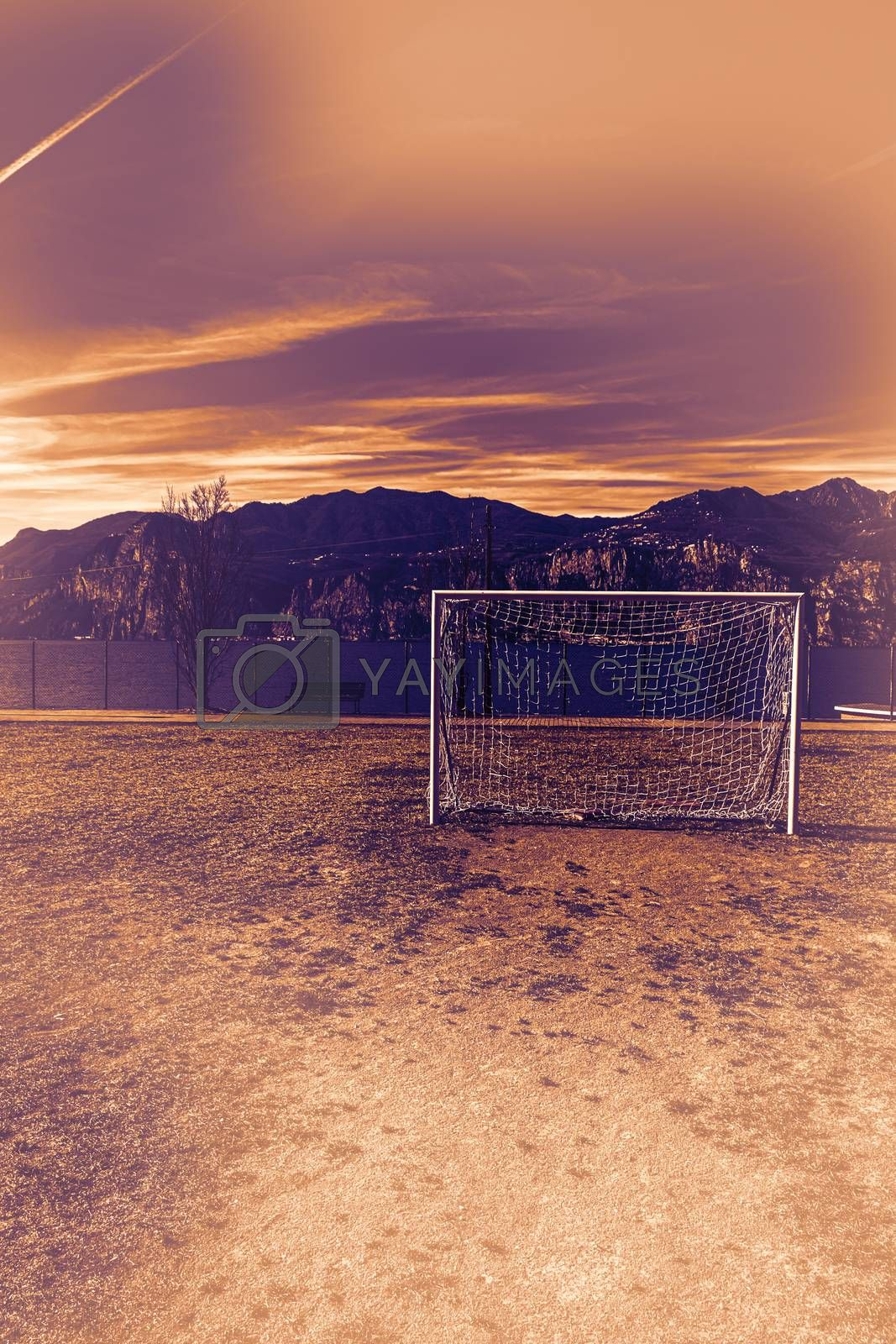 Deserted sports field on the shores of Lake Garda in Italy at dawn in a contemporary style.