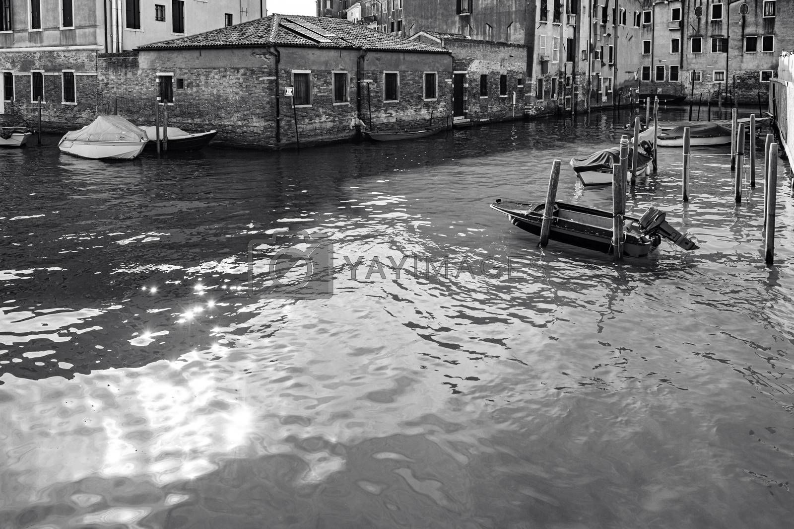 Deserted Venice in black and white. Museum City is situated across a group of islands that are separated by canals and linked by empty bridges.