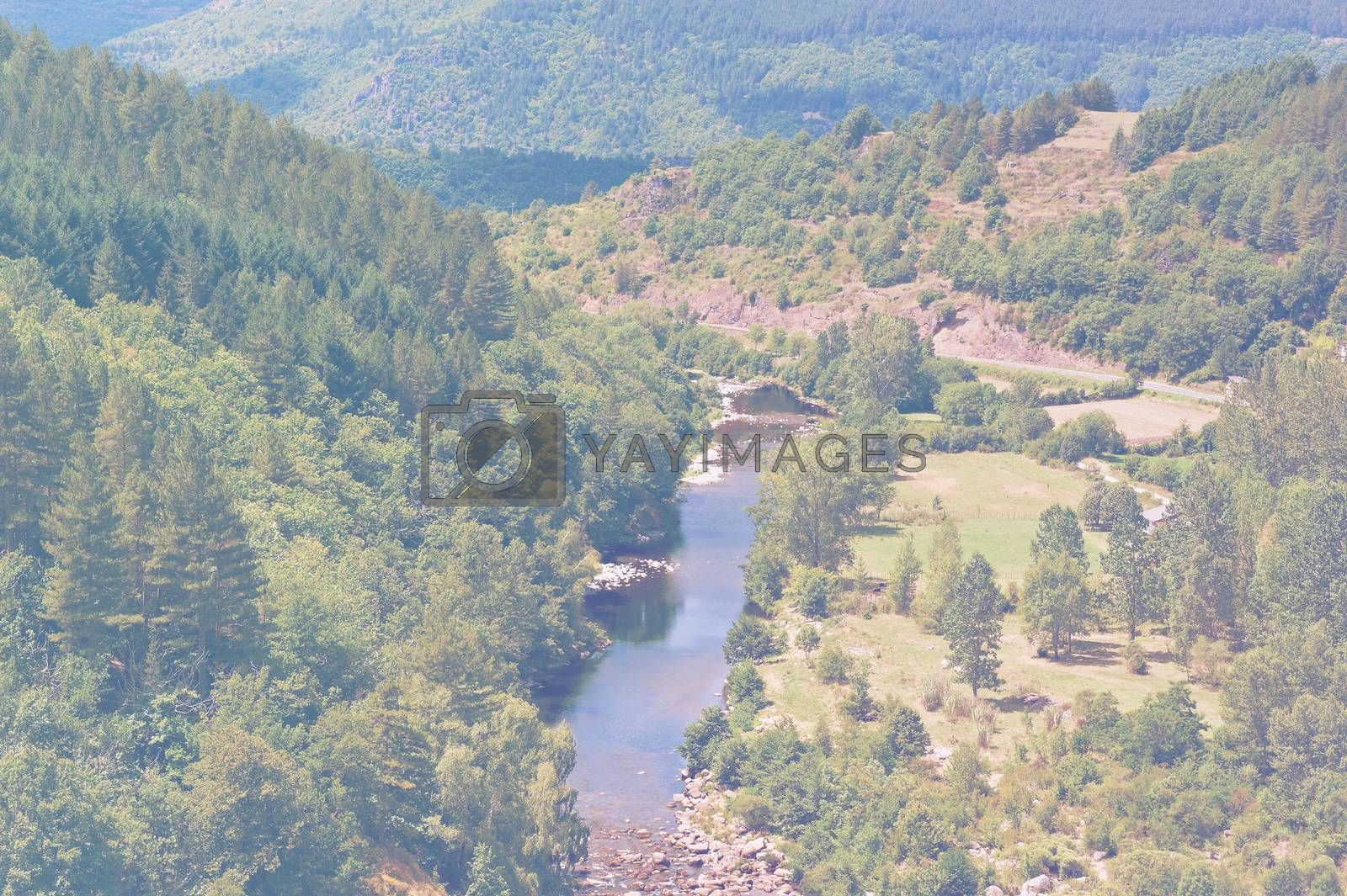 Deserted landscape in France in faded color effect. Lack of tourists on the banks of a mountain river in the French Alps.