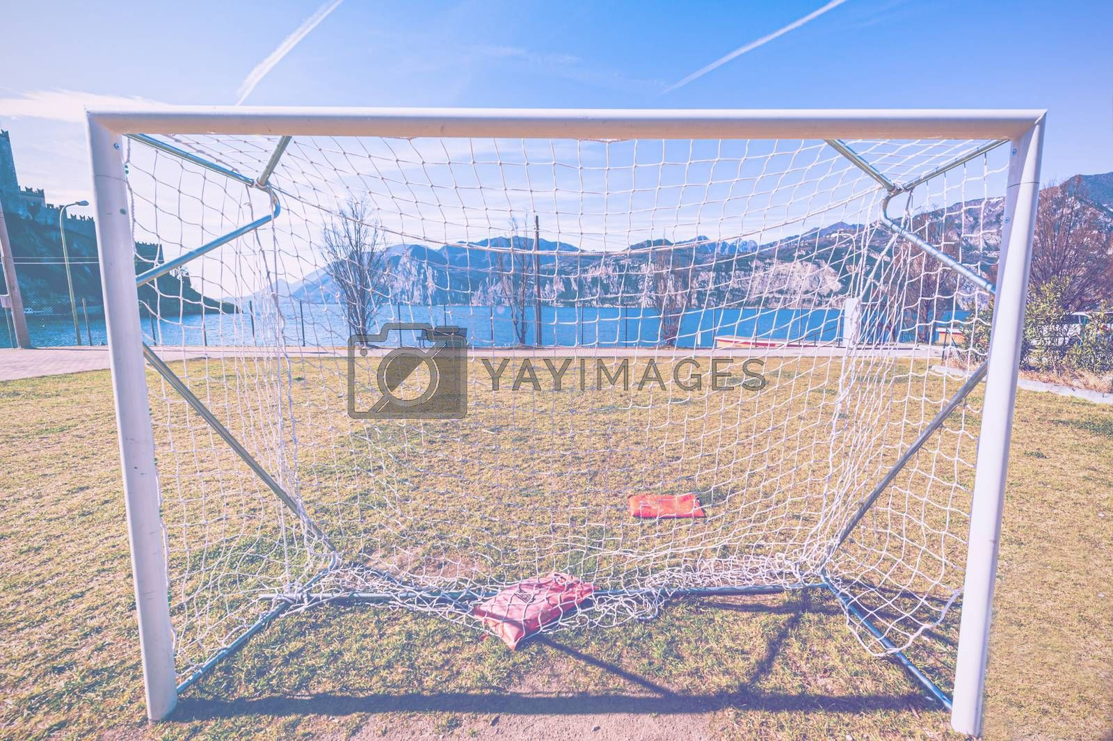 Deserted sports field on the shores of Lake Garda in Italy in faded color effect.
