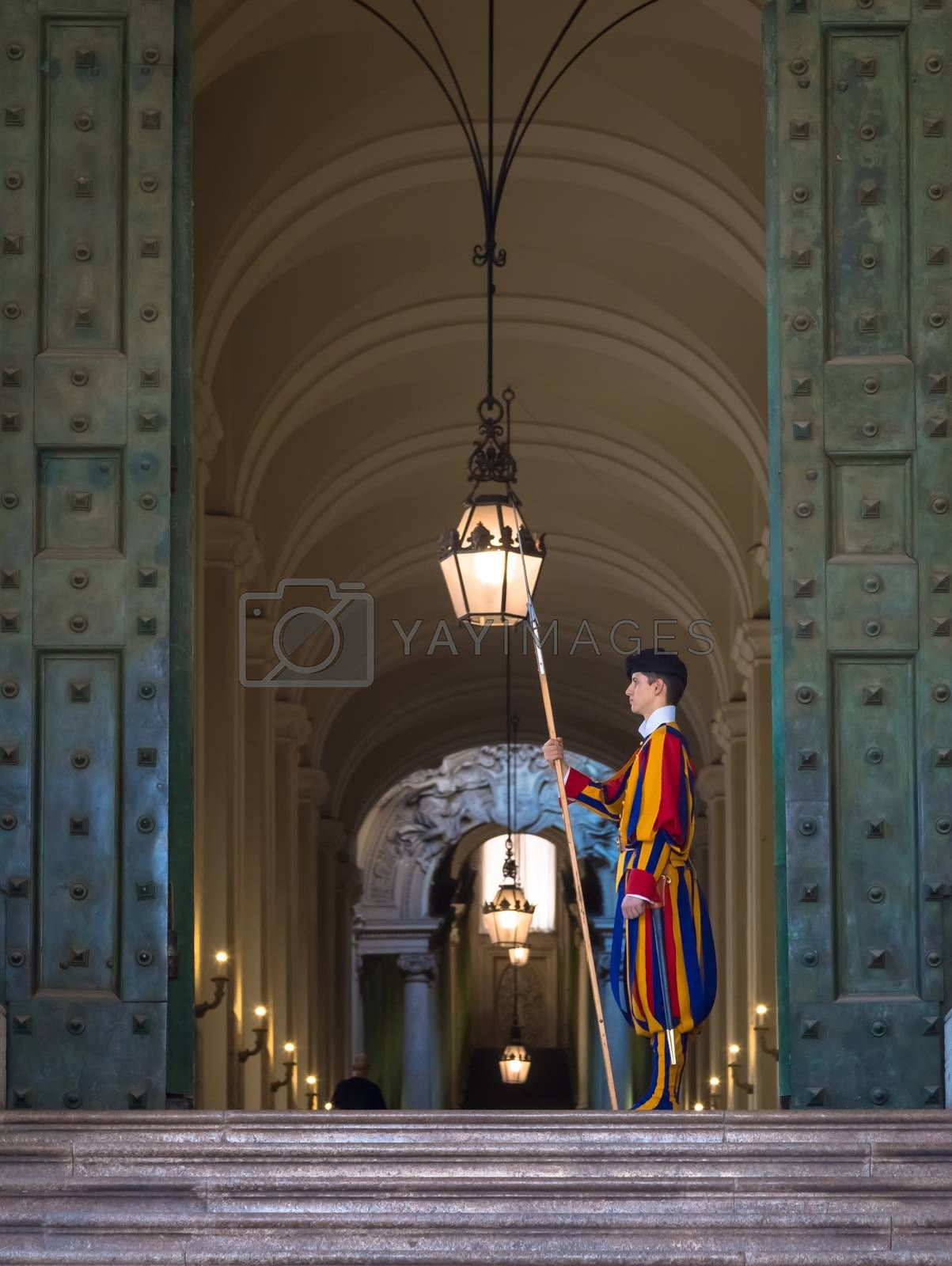 ROME, VATICAN STATE - August 24, 2018: Pontifical Swiss Guard at the entrance of the Vatican State
