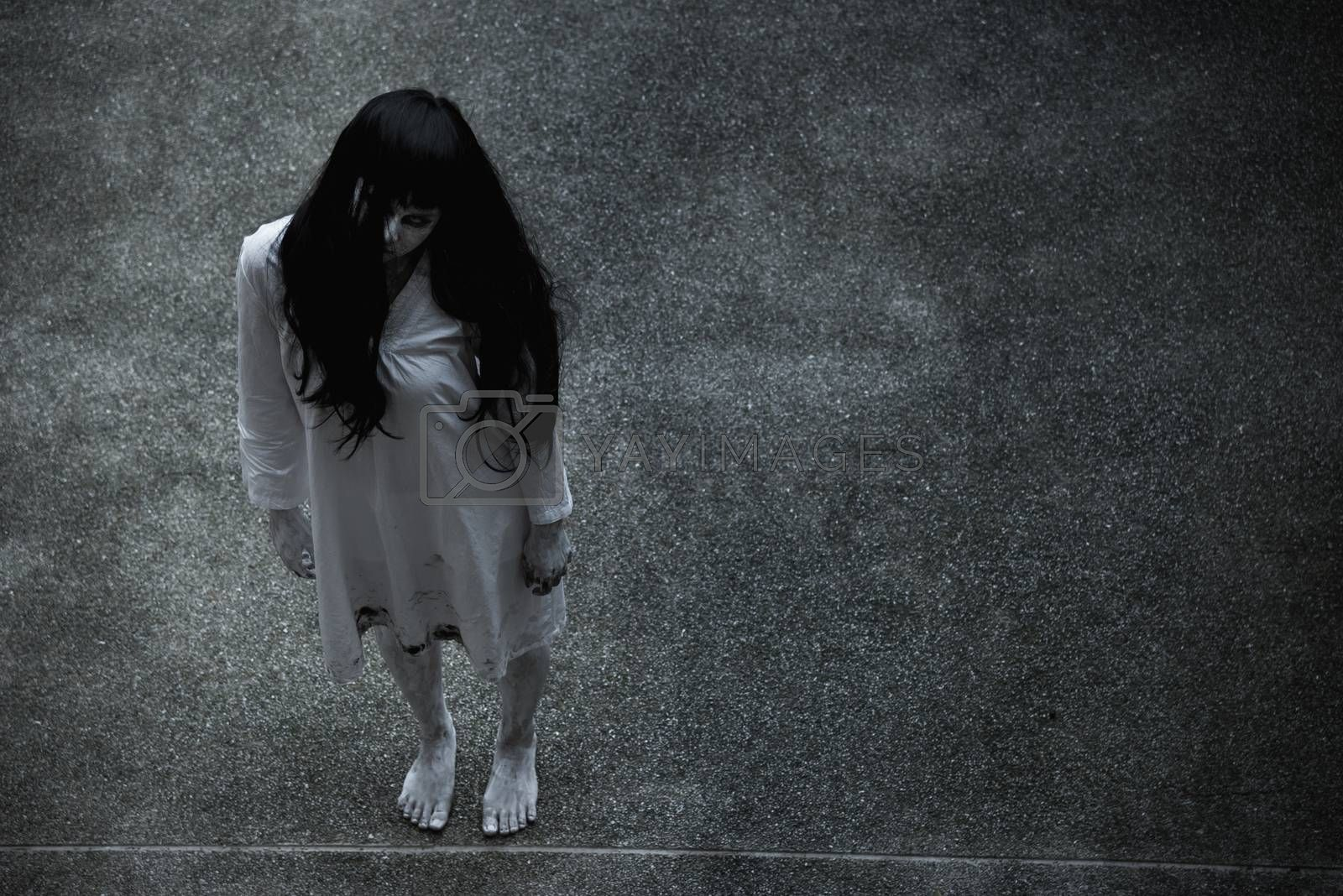 Woman ghost horror standing under building house her looking up, halloween concept
