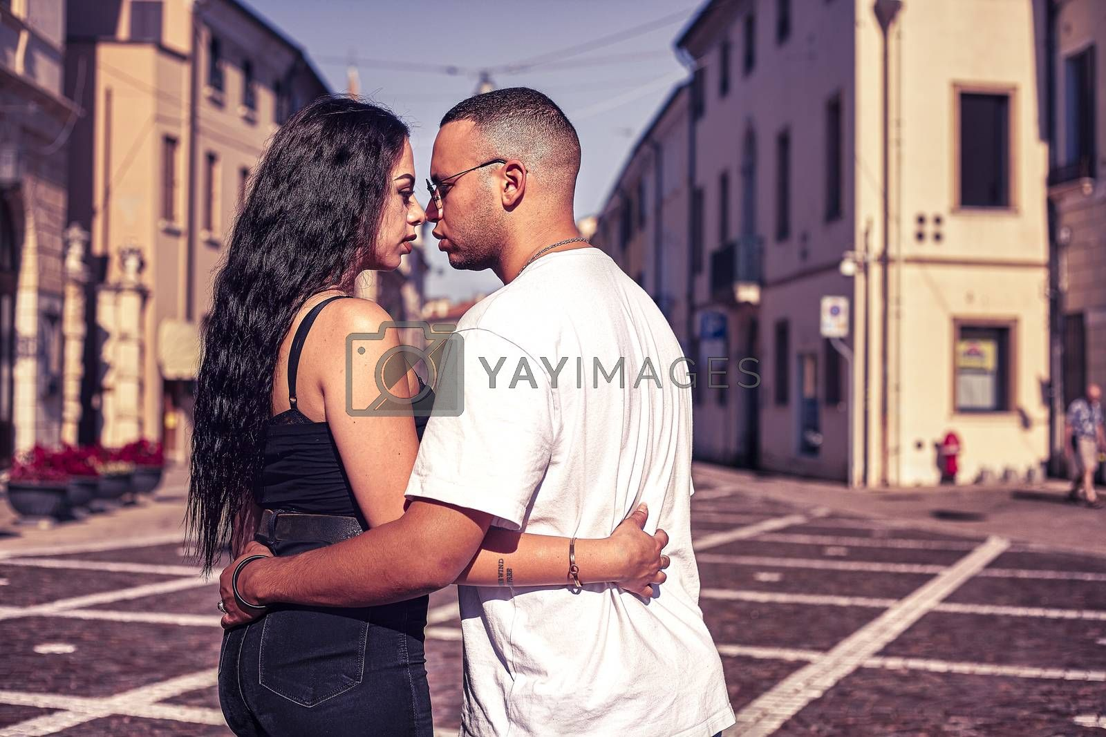 Young love couple embraced in the city at sunset