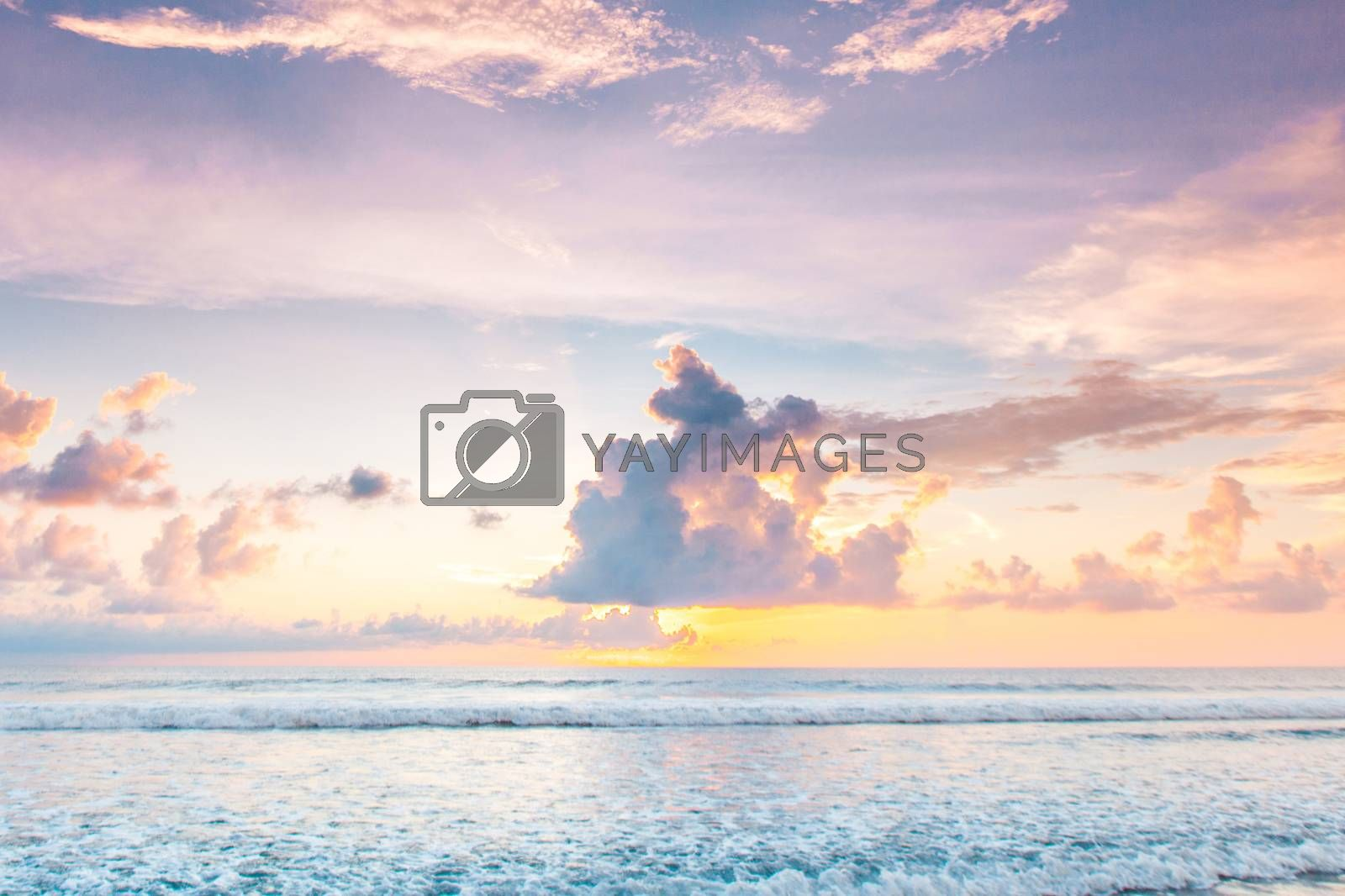 Morning seascape, beautiful sunrise in cloudy sky over the sea