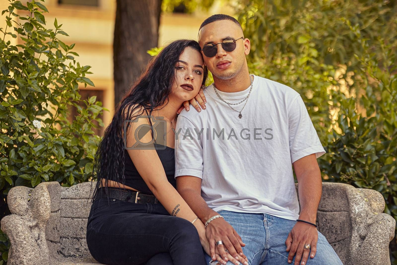 Interracial young couple in Love portrait in a park at sunset