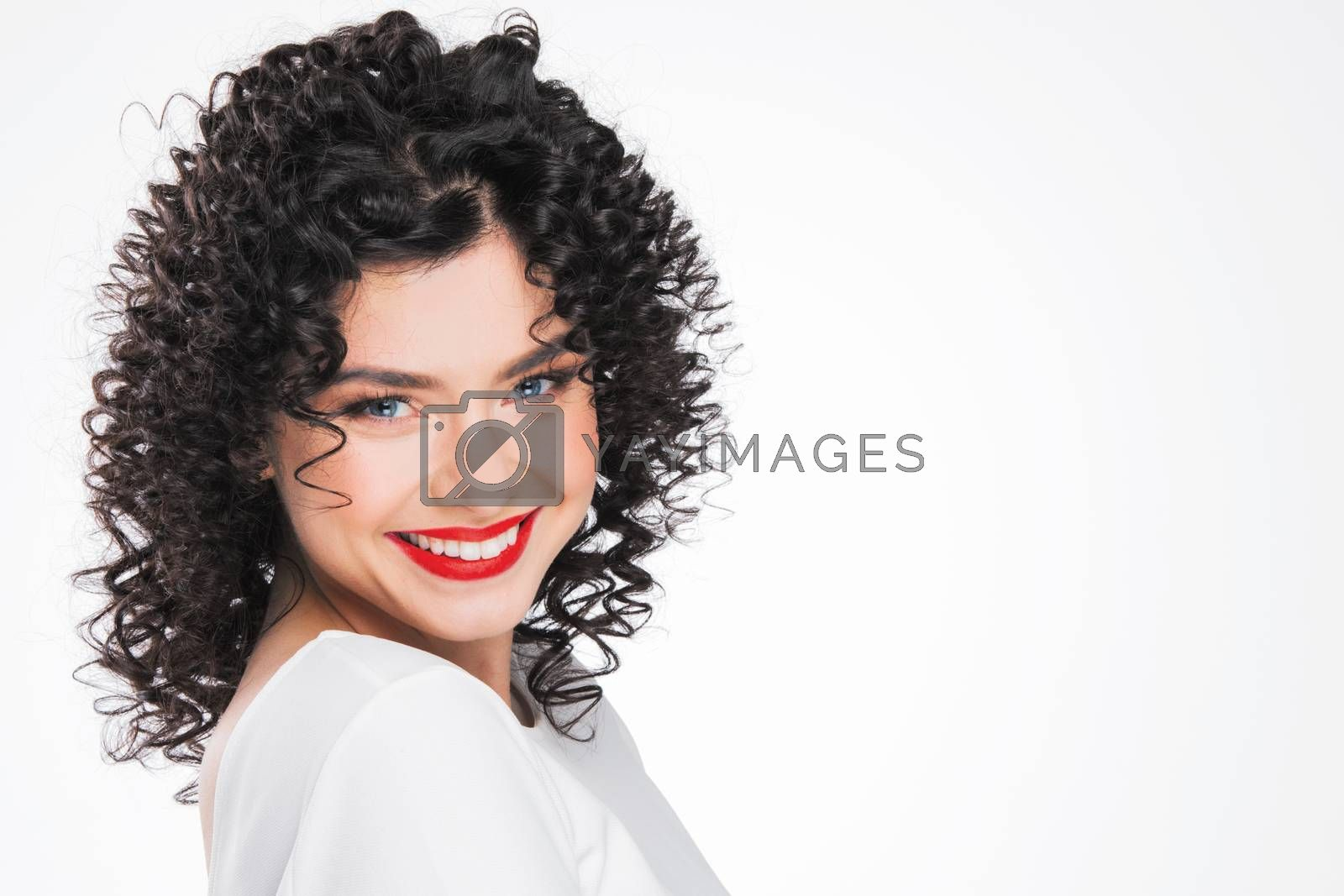 Beauty young woman portrait isolated on white background. Girl with black curly hair. Hairstyle. Haircut