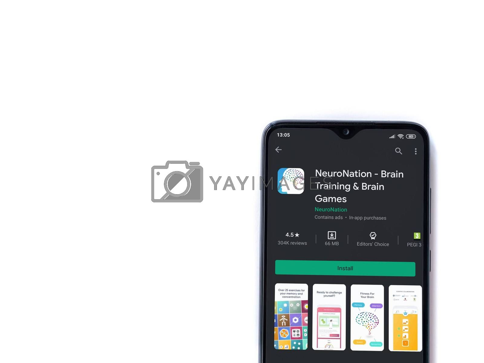 Lod, Israel - July 8, 2020: NeuroNation app play store page on the display of a black mobile smartphone isolated on white background. Top view flat lay with copy space.