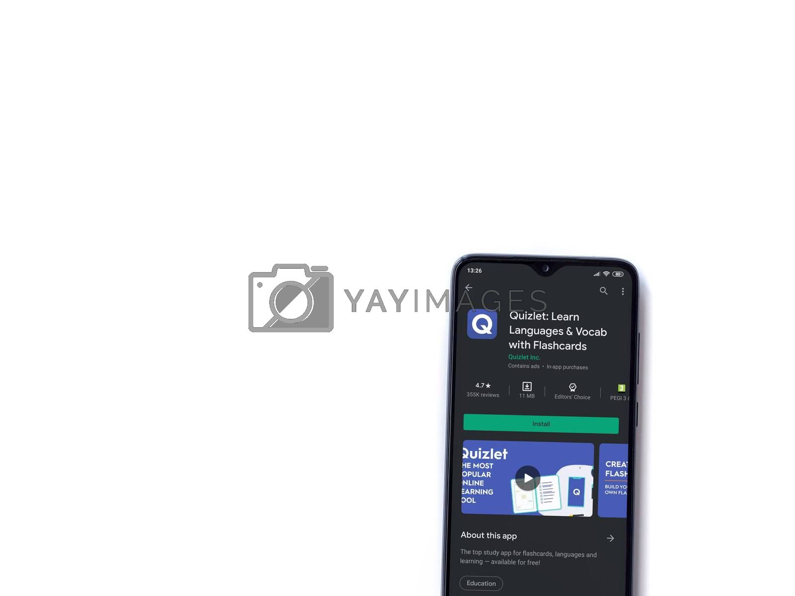Lod, Israel - July 8, 2020: Quizlet - Language learning app play store page on the display of a black mobile smartphone isolated on white background. Top view flat lay with copy space.