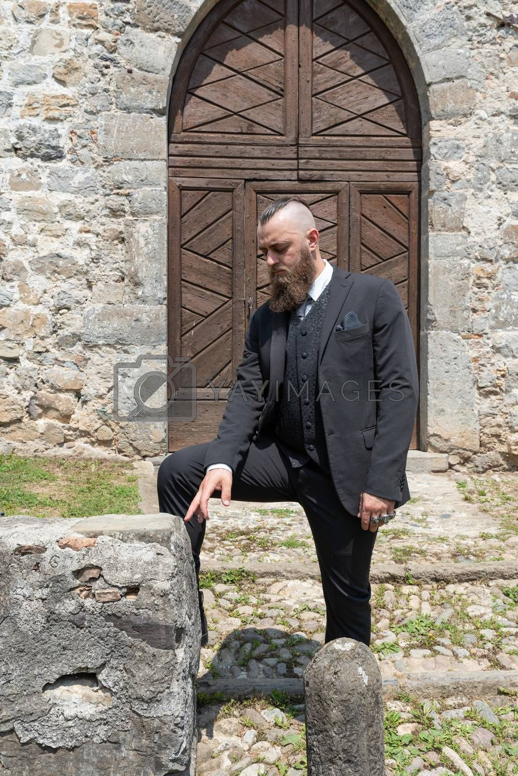 Groom waits for his future wife in front of the church