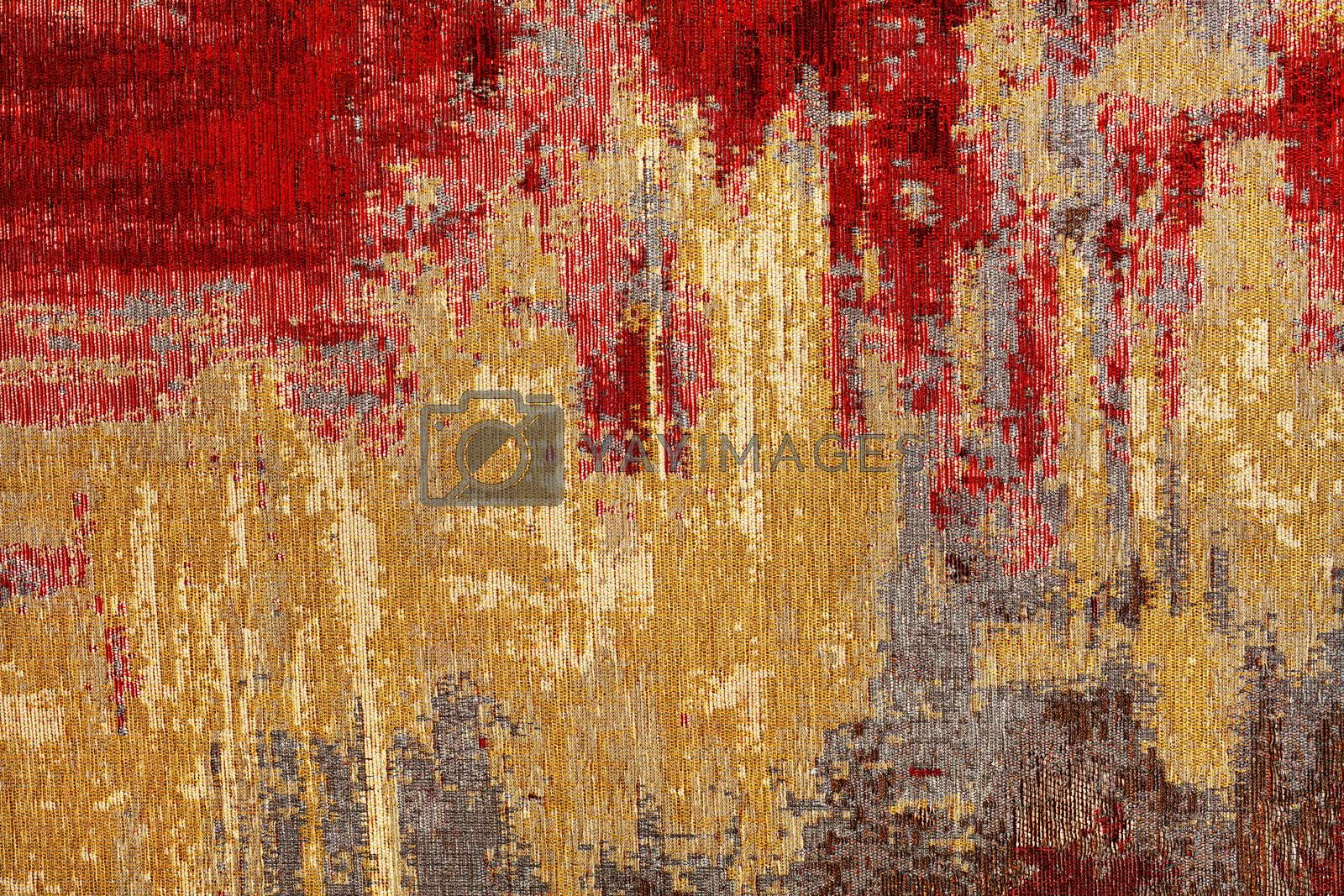 Texture of oriental red-gold carpet tapestry with abstract pattern, closeup.