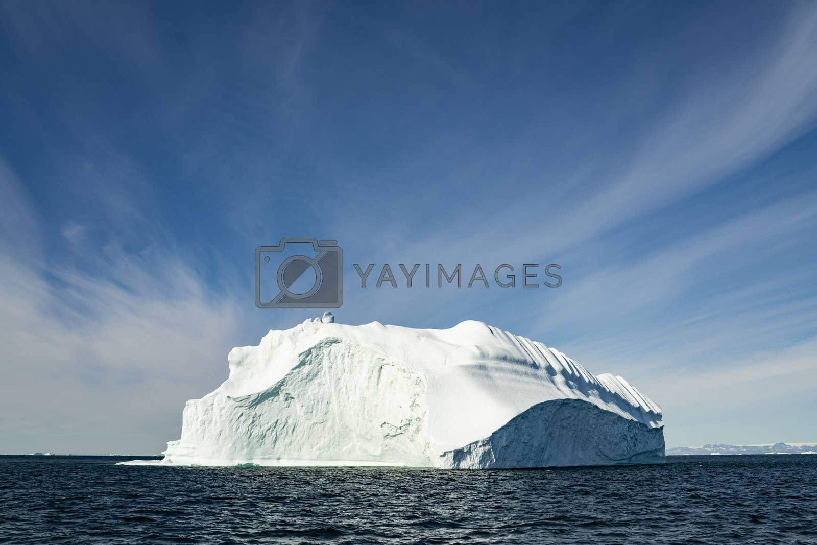 Iceberg from glacier in arctic nature landscape on Greenland. Icebergs in Ilulissat icefjord. Affected by climate change and global warming.