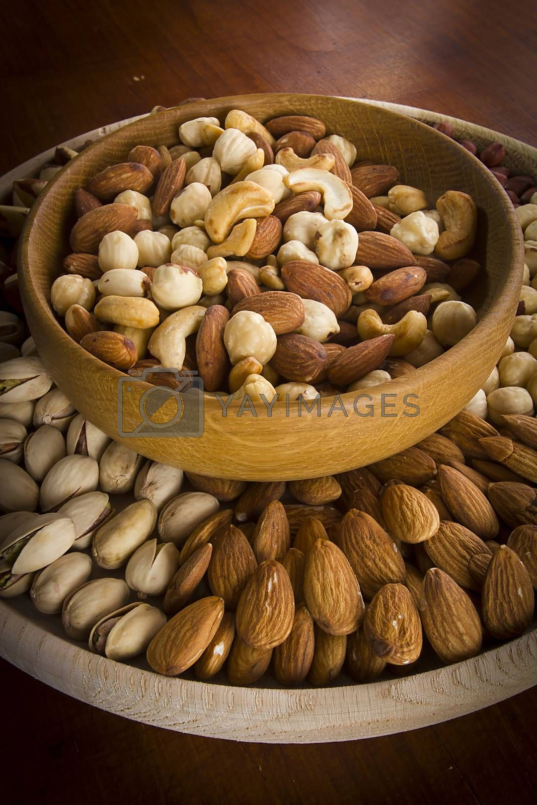 Set of various nuts in a wooden bowl