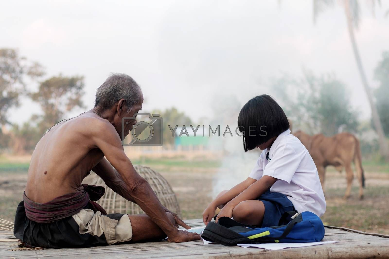 Oldman and girl in the countryside of Thailand.