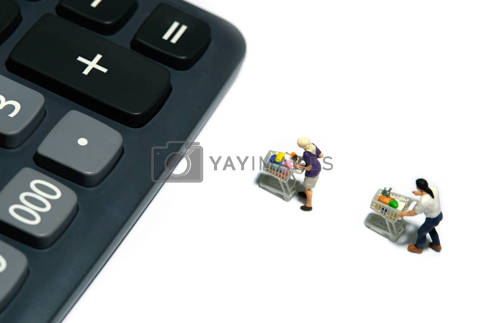people with cart lining up to calculator, calculate total purchase for groceries. Miniature people figurines toys conceptual photography.
