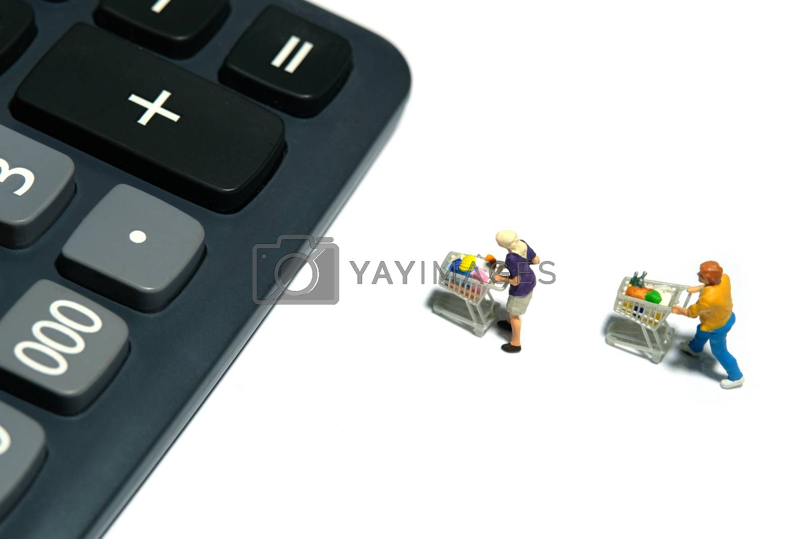 Miniature people figurines toys conceptual photography.people with cart lining up to calculator, calculate total purchase for groceries. Miniature people figurines toys conceptual photography.
