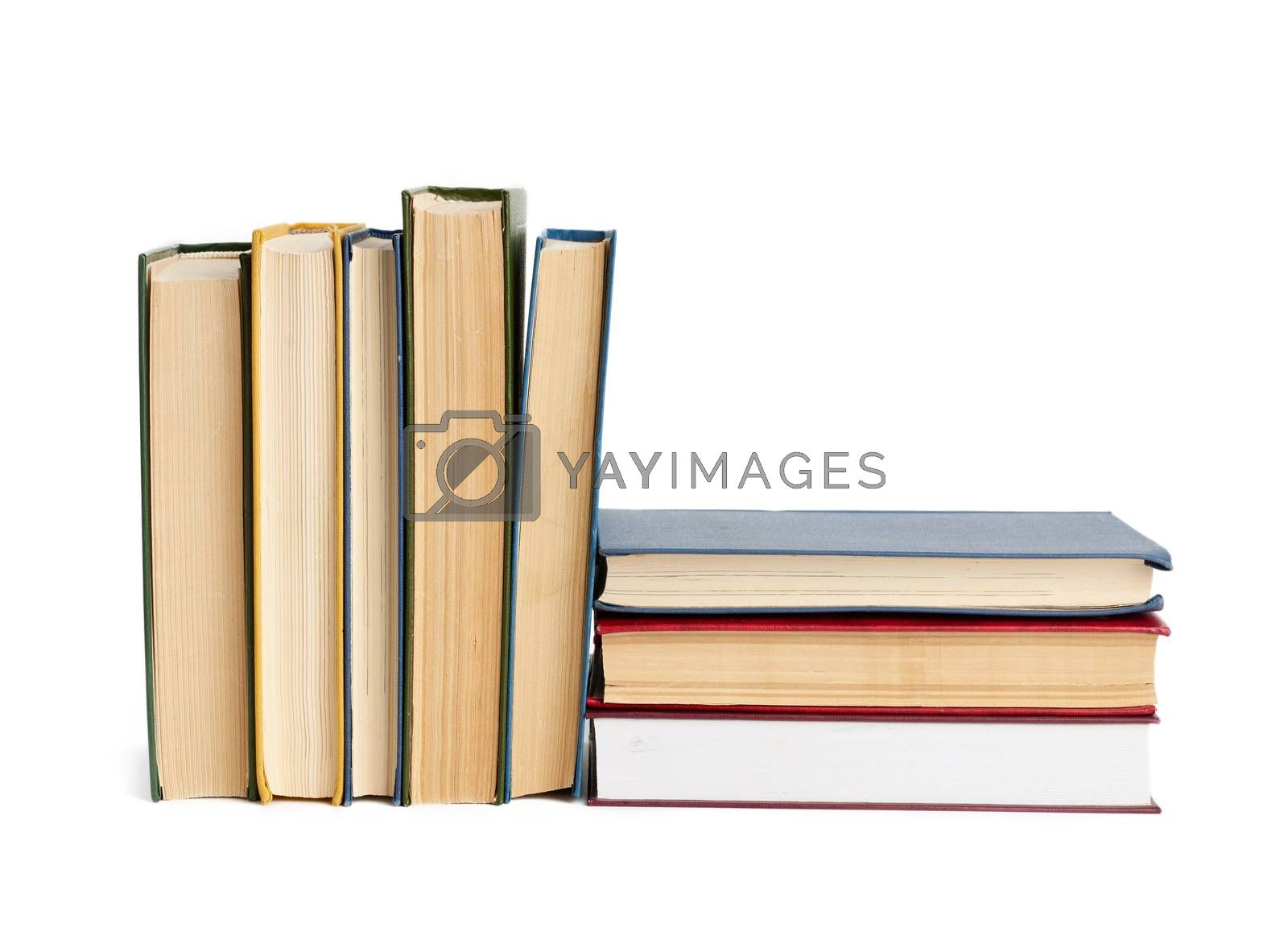 stack of various books, items are isolated on white background, close up