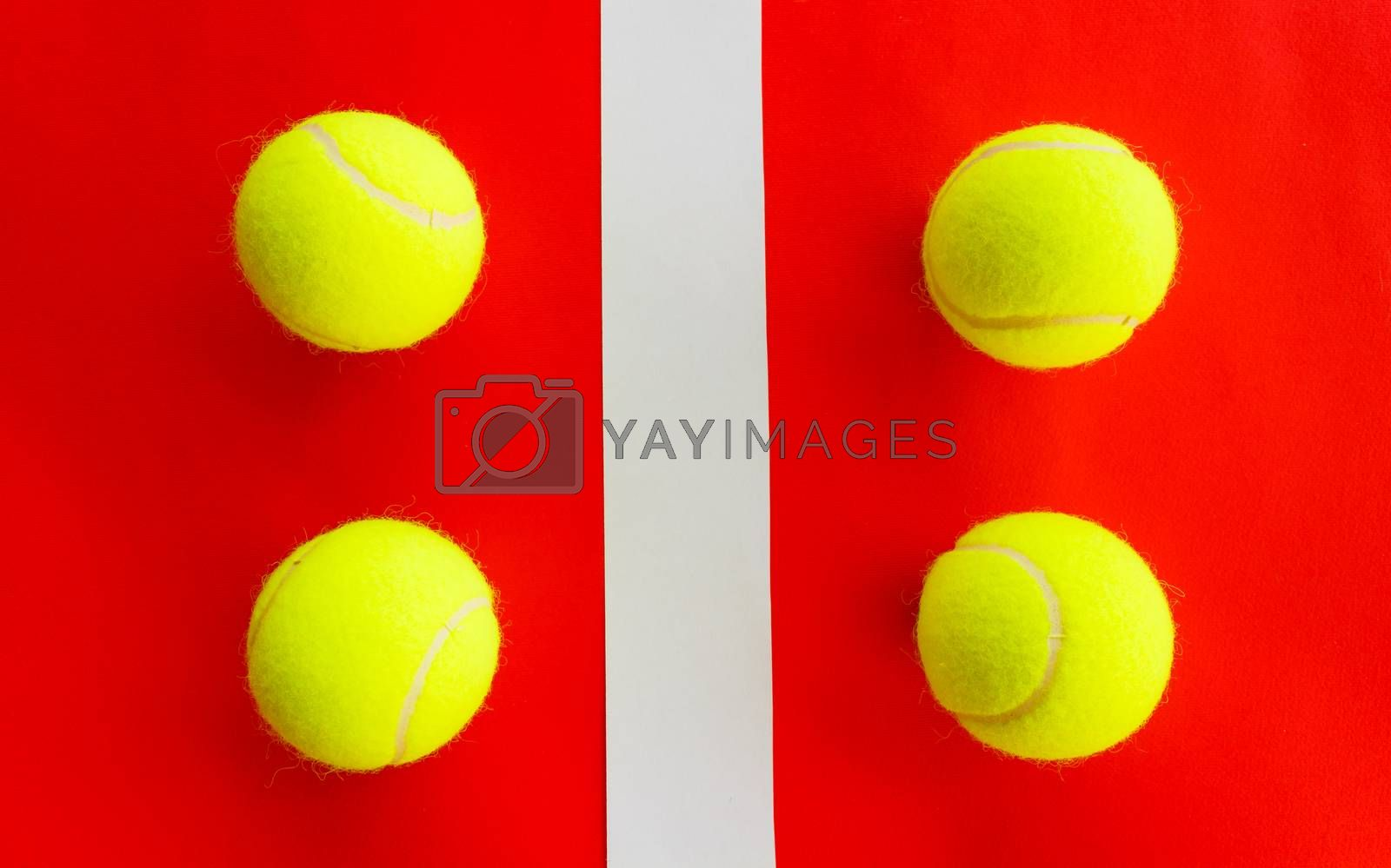 four tennis balls divided by a field line they represent a  double encounter