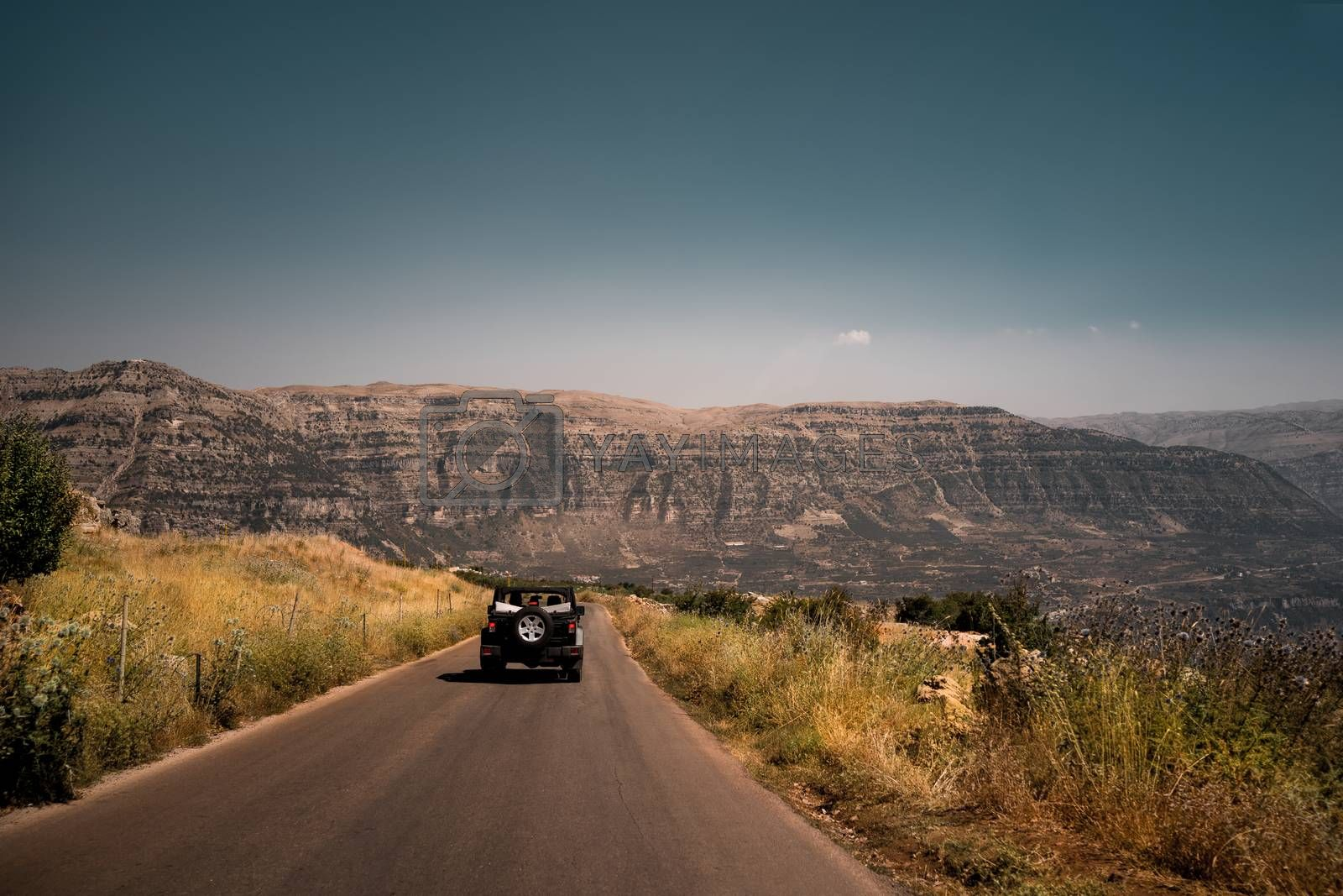 Road Trip. Car Drives on a Deserted Road Towards the Mount Lebanon. Traveling in the Car. Active Summer Vacation.