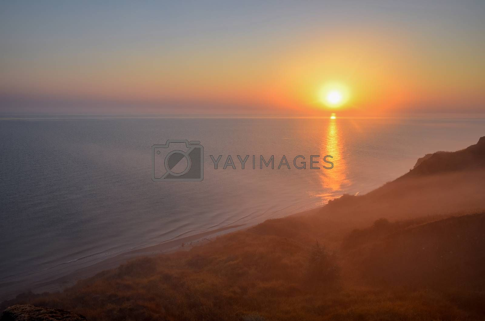 Dawn over the sea. Sea of Azov. Morning mist over the shore. Sunrise