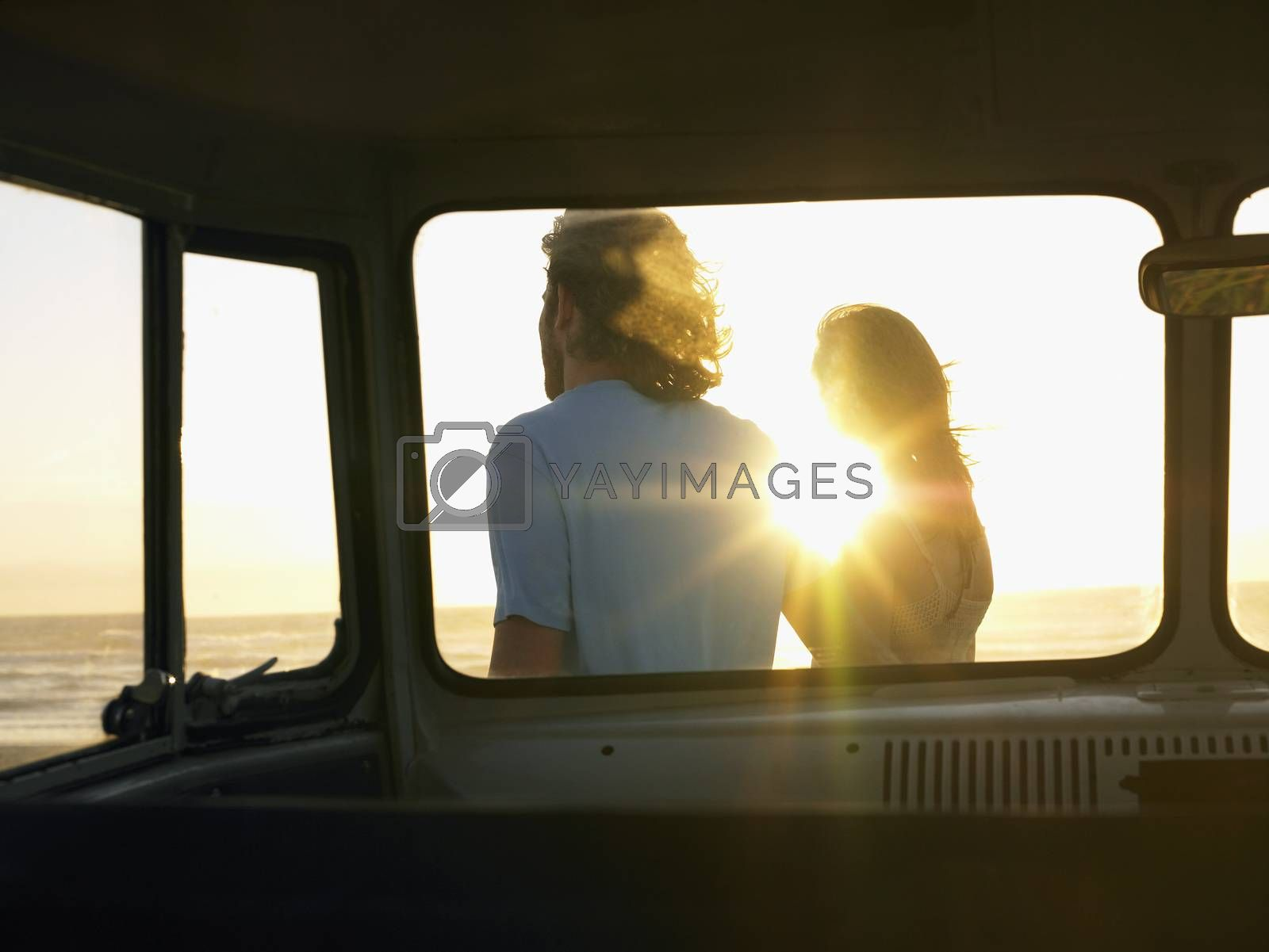 Young couple on Beach view through camper van