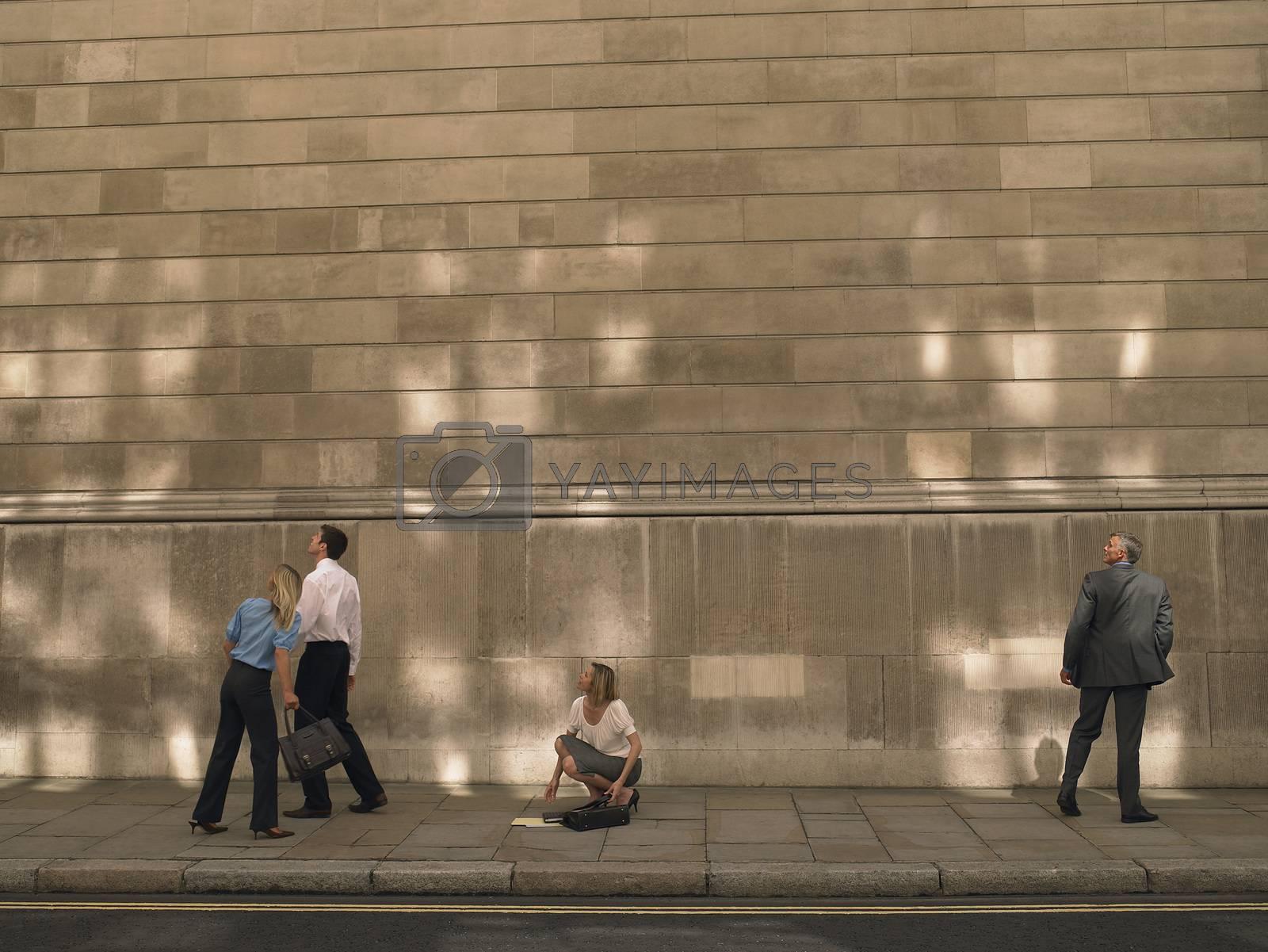 People on sidewalk looking up