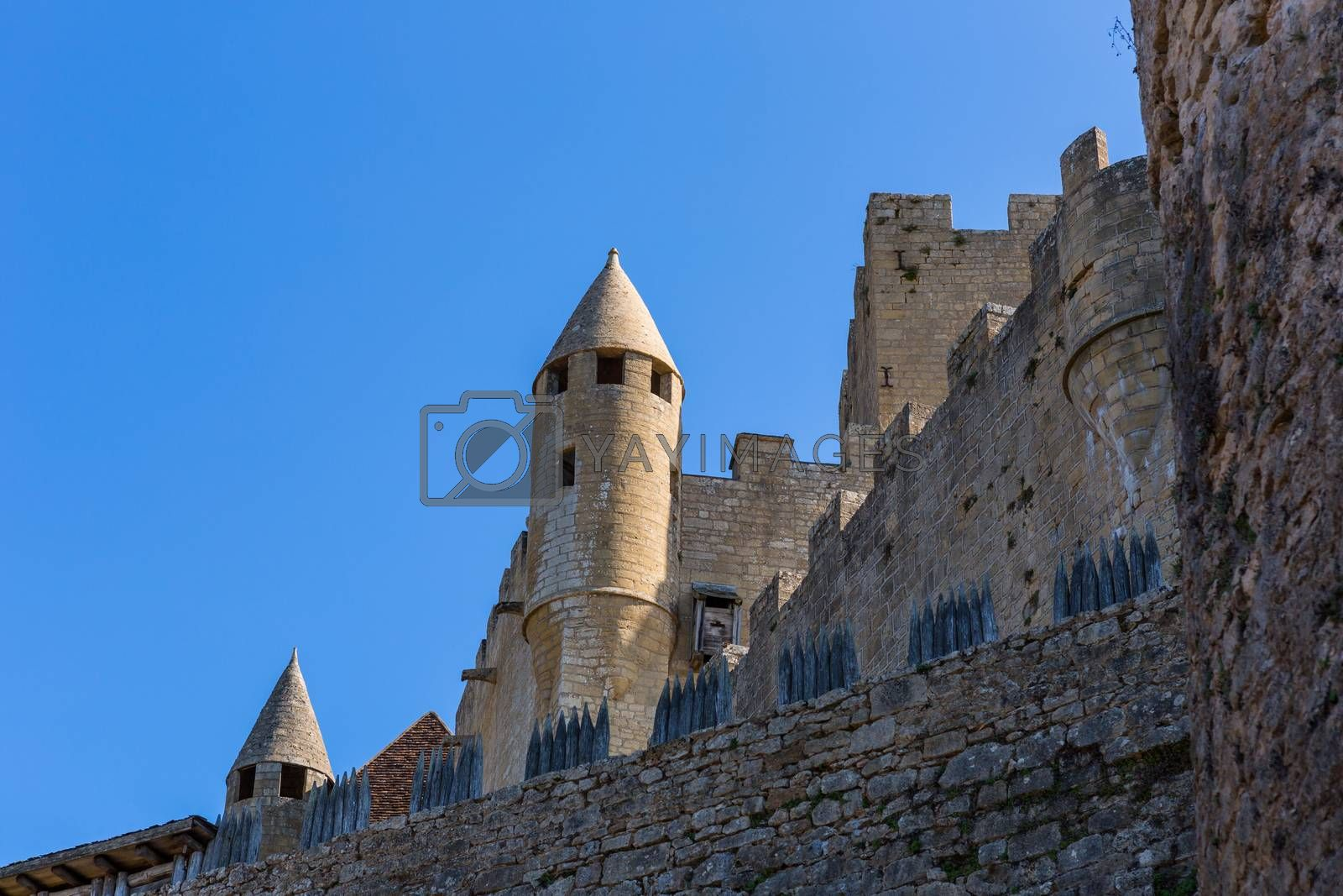 The medieval Chateau de Beynac rising on a limestone cliff above the Dordogne River. France, Dordogne department, Beynac-et-Cazenac