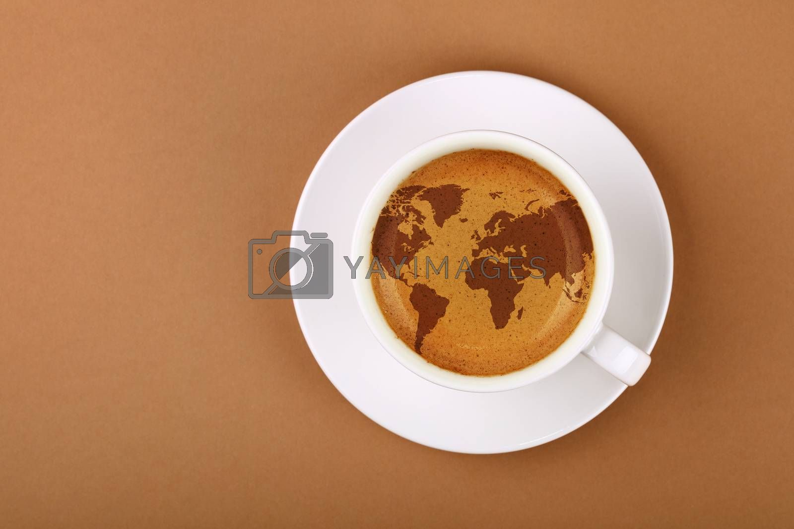 Close up white cup on saucer, full of espresso coffee with world map on froth crema, over background of brown paper with copy space, elevated top view, directly above