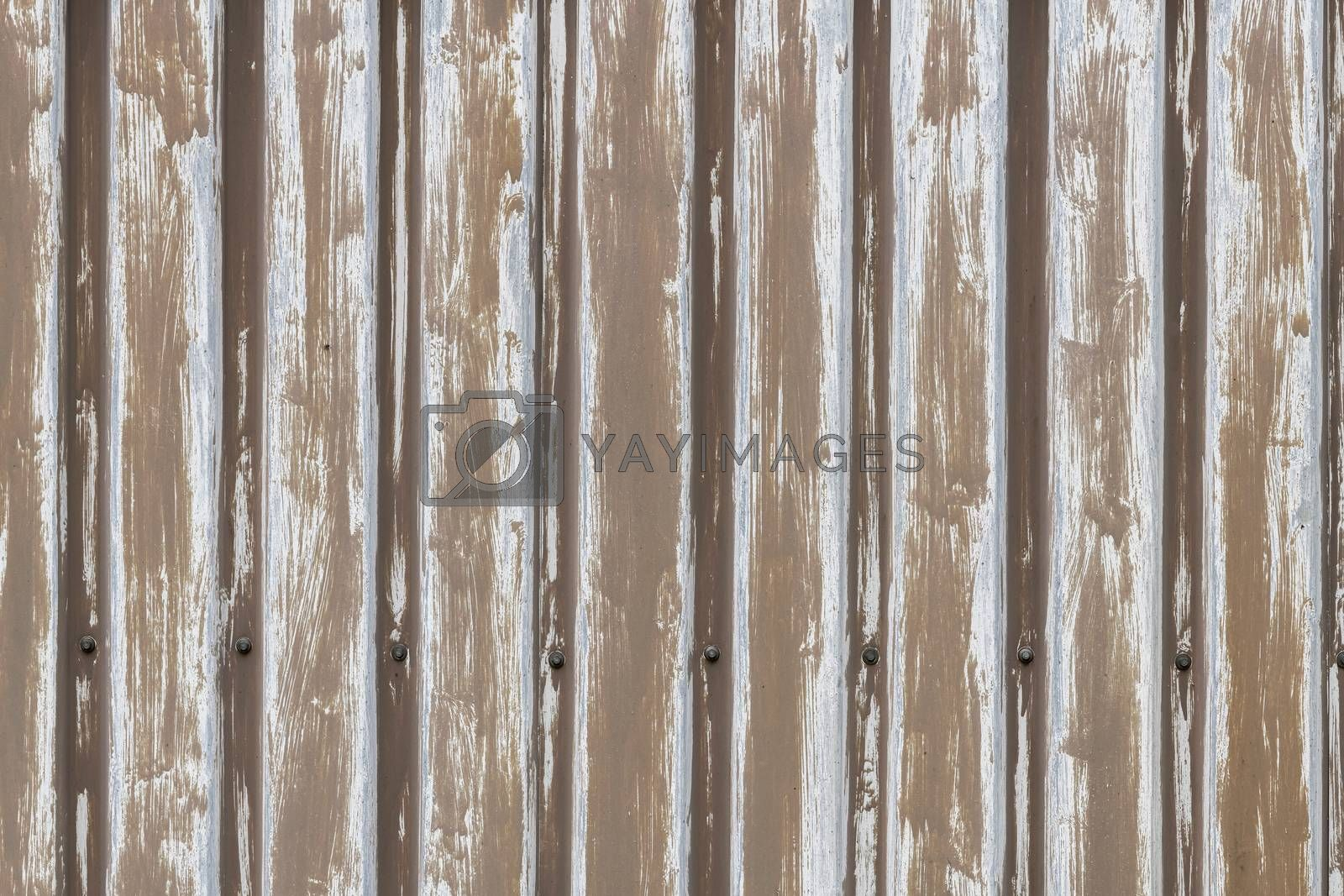 Background photo of brown sheet pile profiles on an old shed shown full-screen