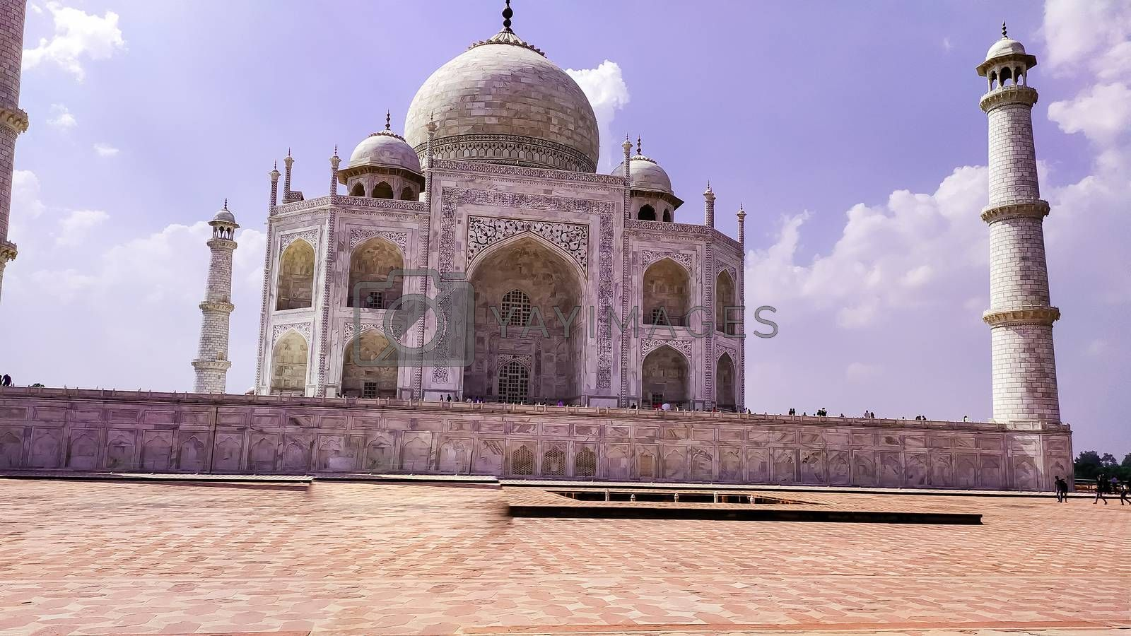 Front view Taj Mahal Tomb mausoleum with large pavilion in the foreground. It is a white marble of Mughal emperor Shah Jahan in memory of his wife Mumtaj. Taj Mahal is jewel of Muslim art and masterpieces of world heritage. Agra, Uttar Pradesh India South Asia Pac May 2019