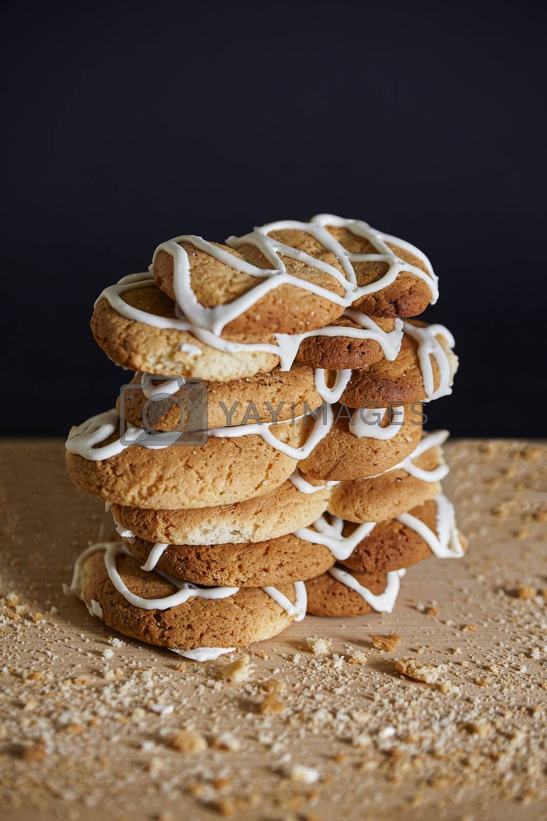 Stack of handmade cookies on wooden table, studio photo