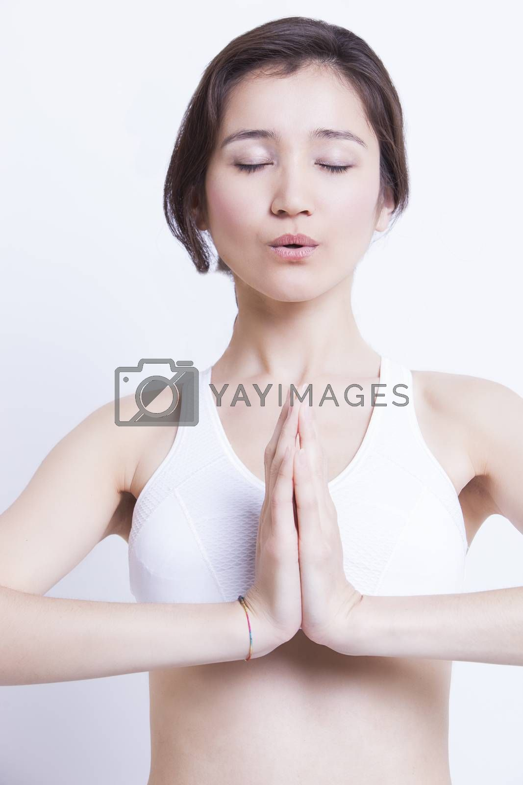 Portrait of young asian girl doing yoga