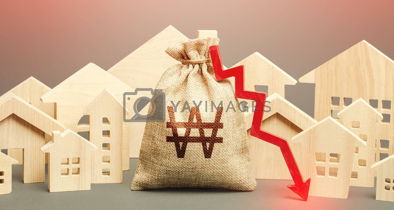 City residential buildings and south korean won money bag with a red down arrow. Low demand for home buying. Lower mortgage interest rates. Falling prices for rental apartments. Low cost real estate.
