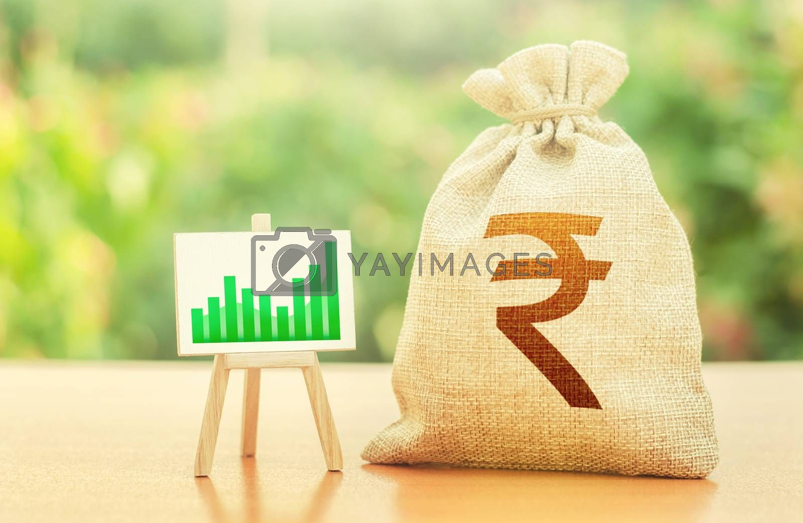 Indian rupee money bag and easel with green positive growth graph. Economic development. Business sentiment. High deposits profitability. Recovery and growth of economy, good investment attractiveness