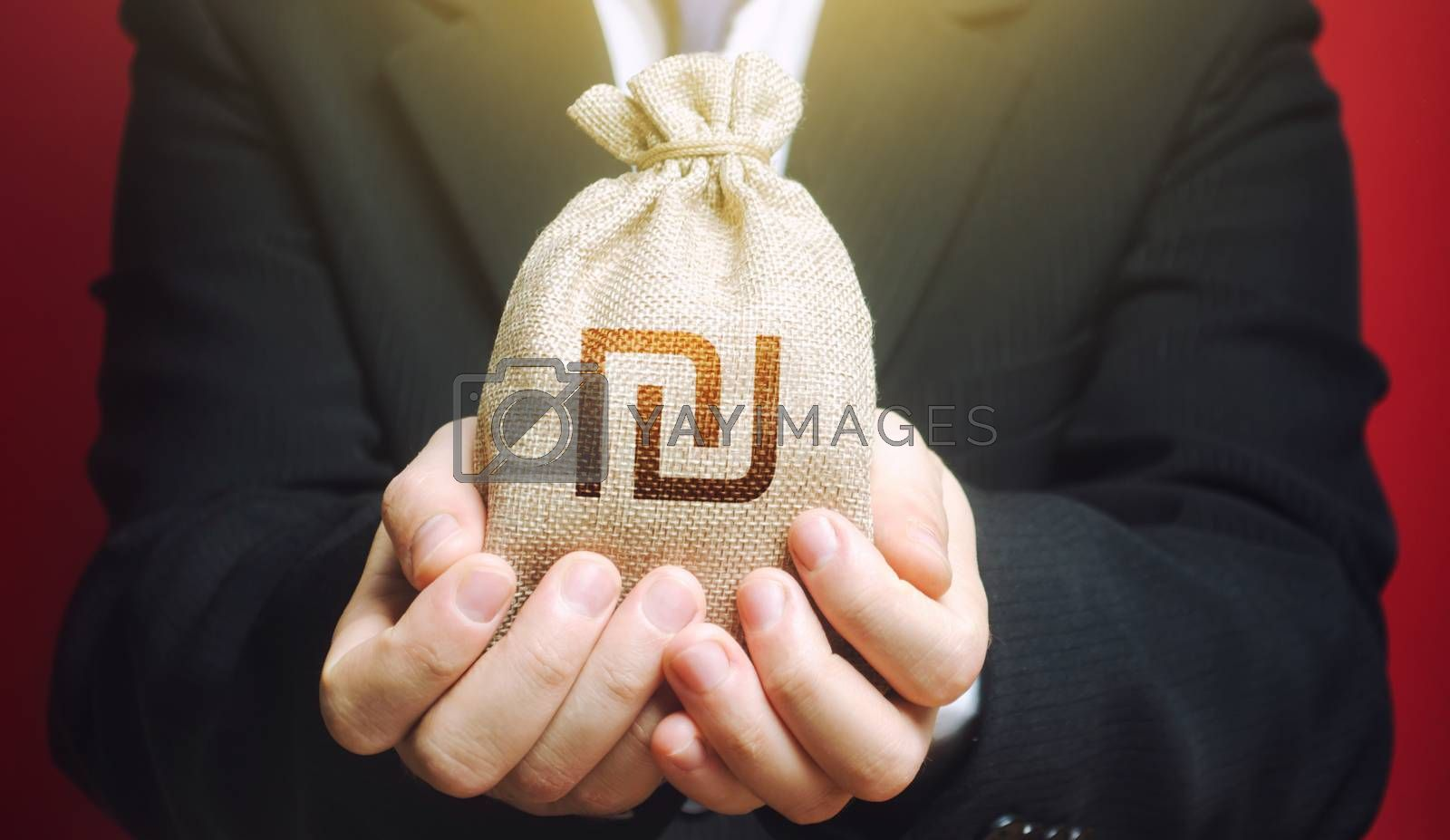 Man holds out a Israeli shekel money bag. Budget management, collect taxes. Bank issuance of credit and loans borrowings to business. Insurance payout. Financial crisis support, benefits, subsidies.