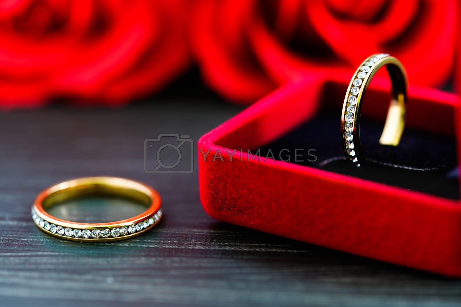 Diamond  wedding ring in red jewel box by stoonn