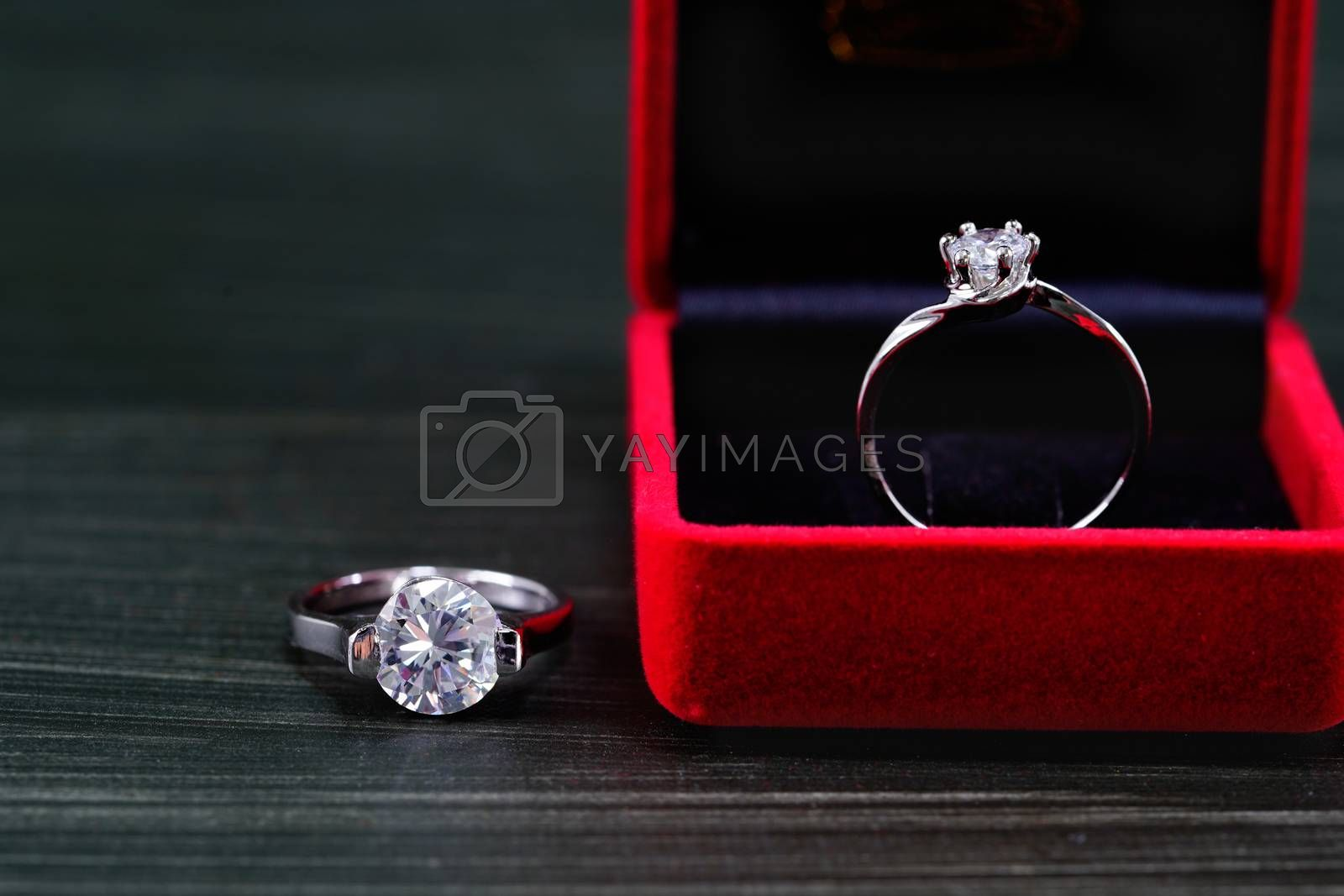 Diamond ring in red jewel box by stoonn