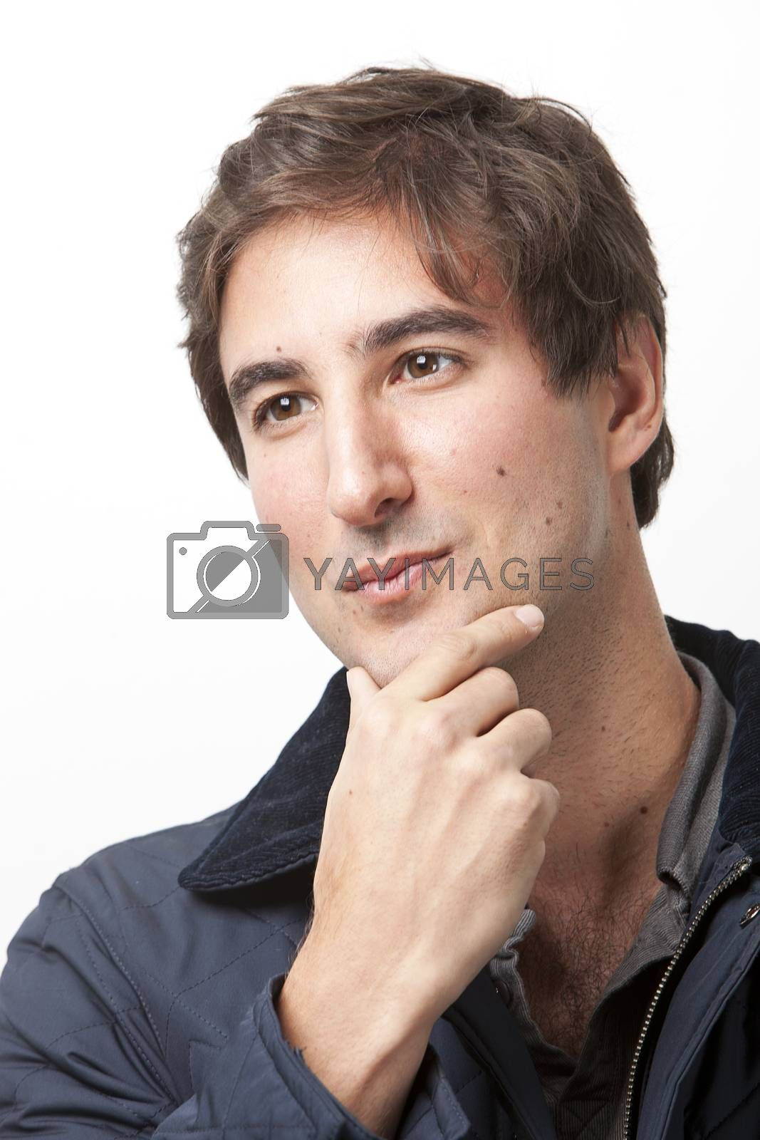 Close-up of young man thinking against white background