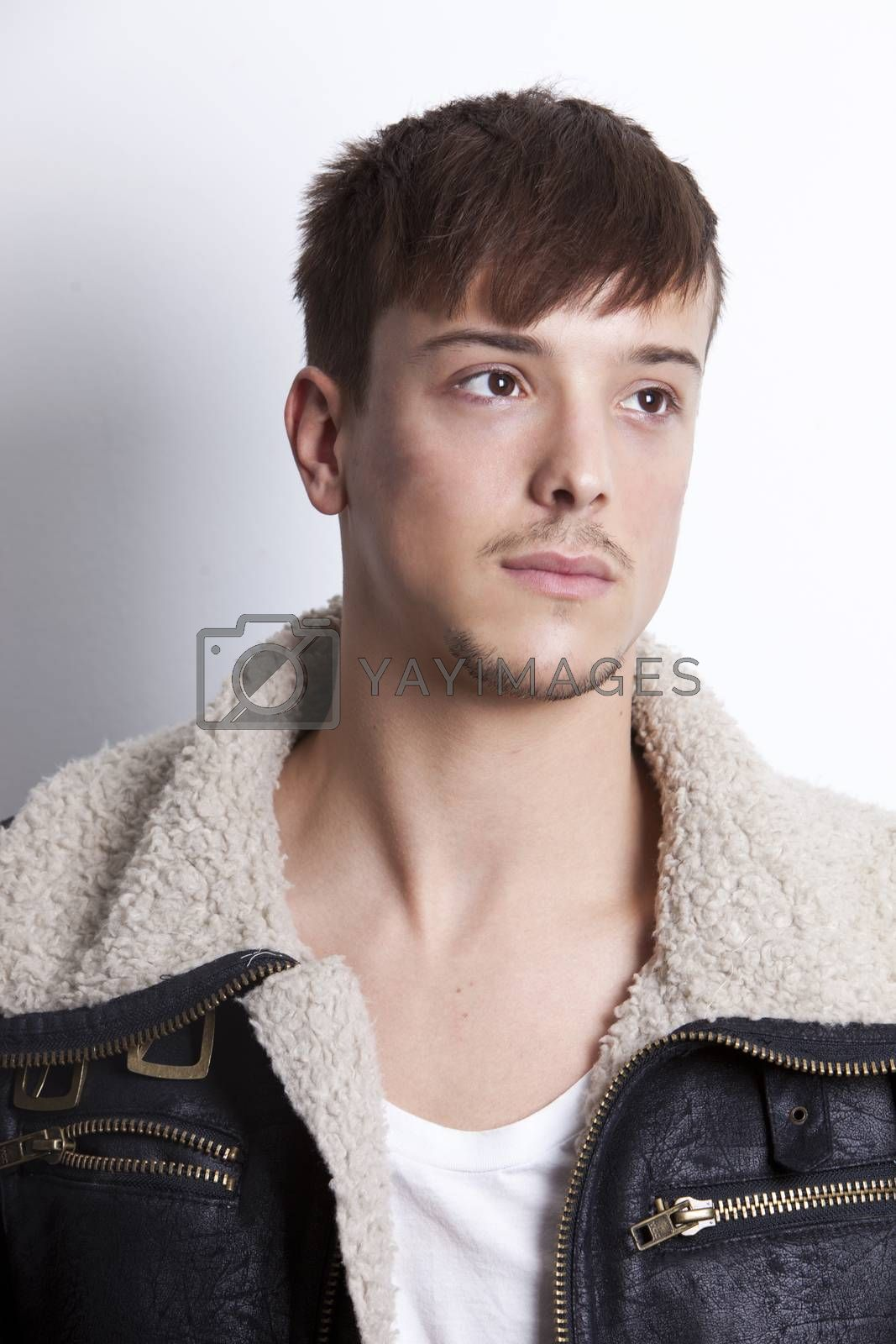 Thoughtful young man looking away against white background
