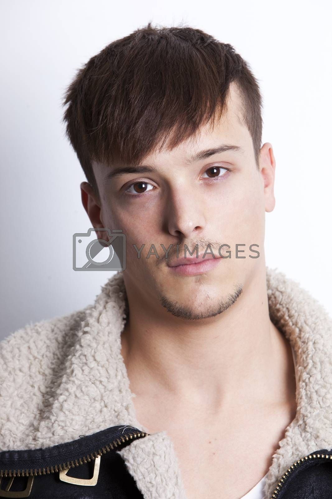 Portrait of handsome young man against white background