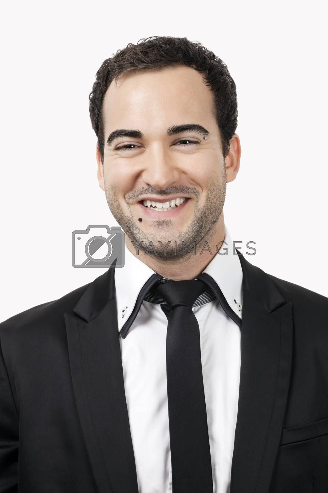 Portrait of young Caucasian businessman against white background