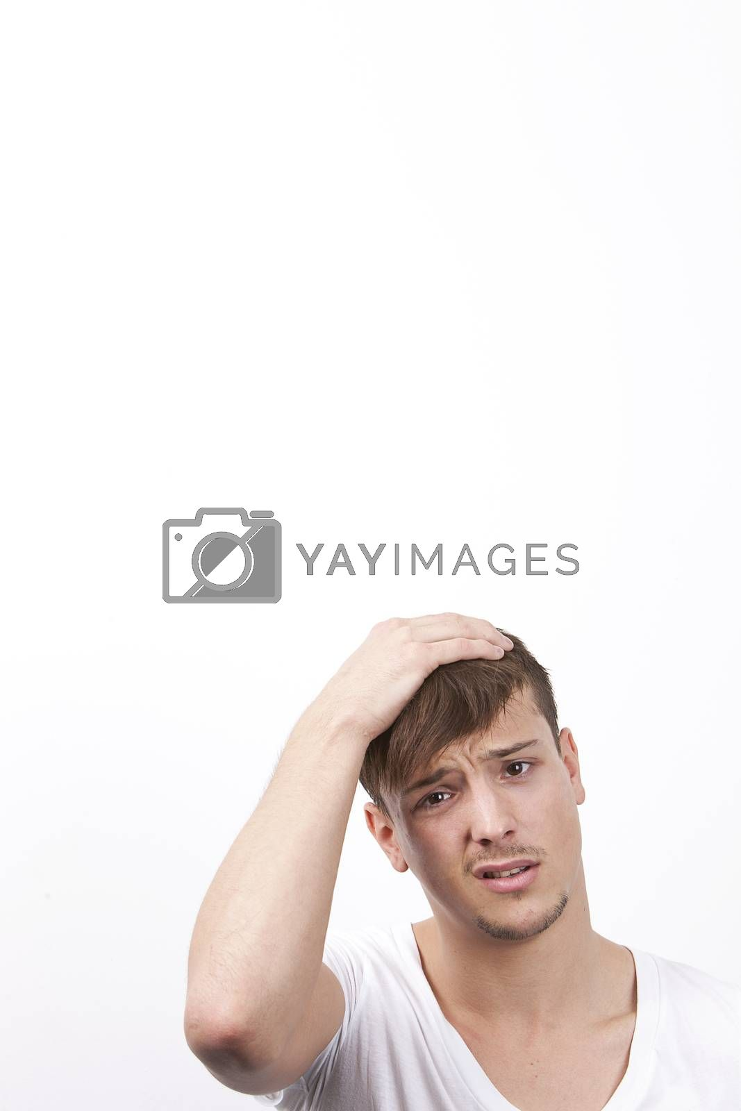 Portrait of confused young man against white background