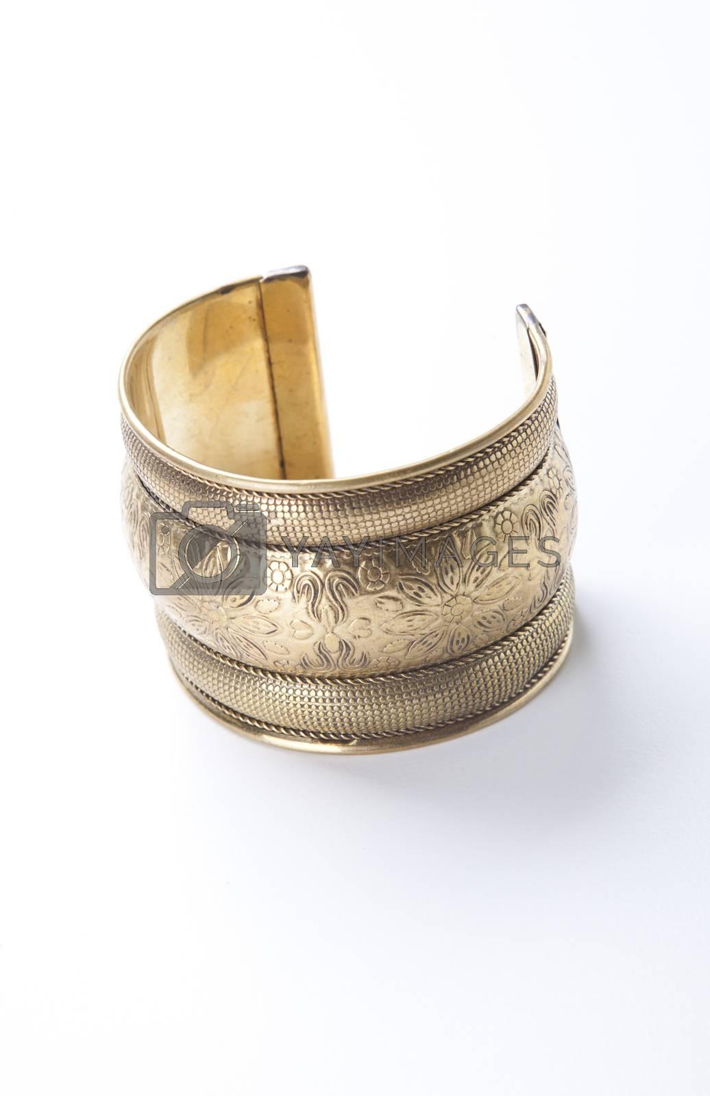 Trendy gold bracelet over white background