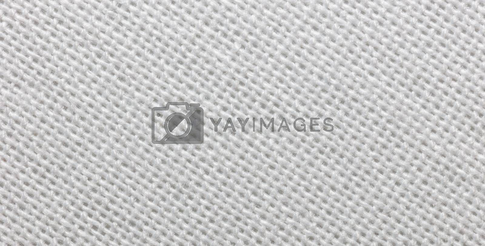 Close-up view of a piece of white fabric. Macro shot. Texture.