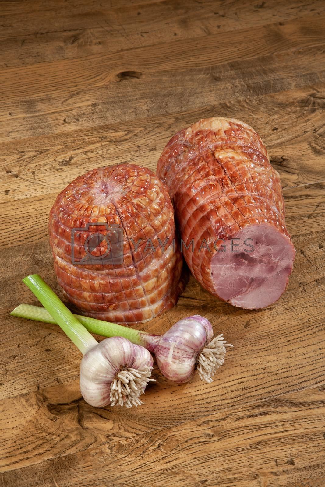 Ham sausage and garlic on a wooden desk