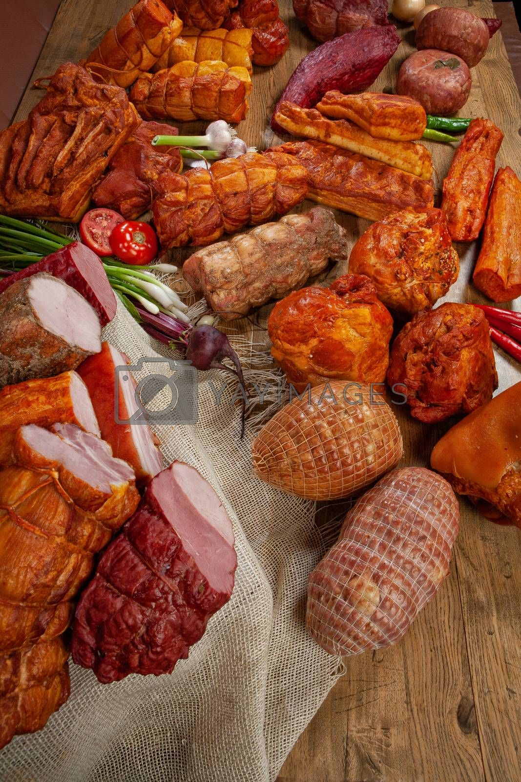 Different kinds of meat and vegetables on a studio background