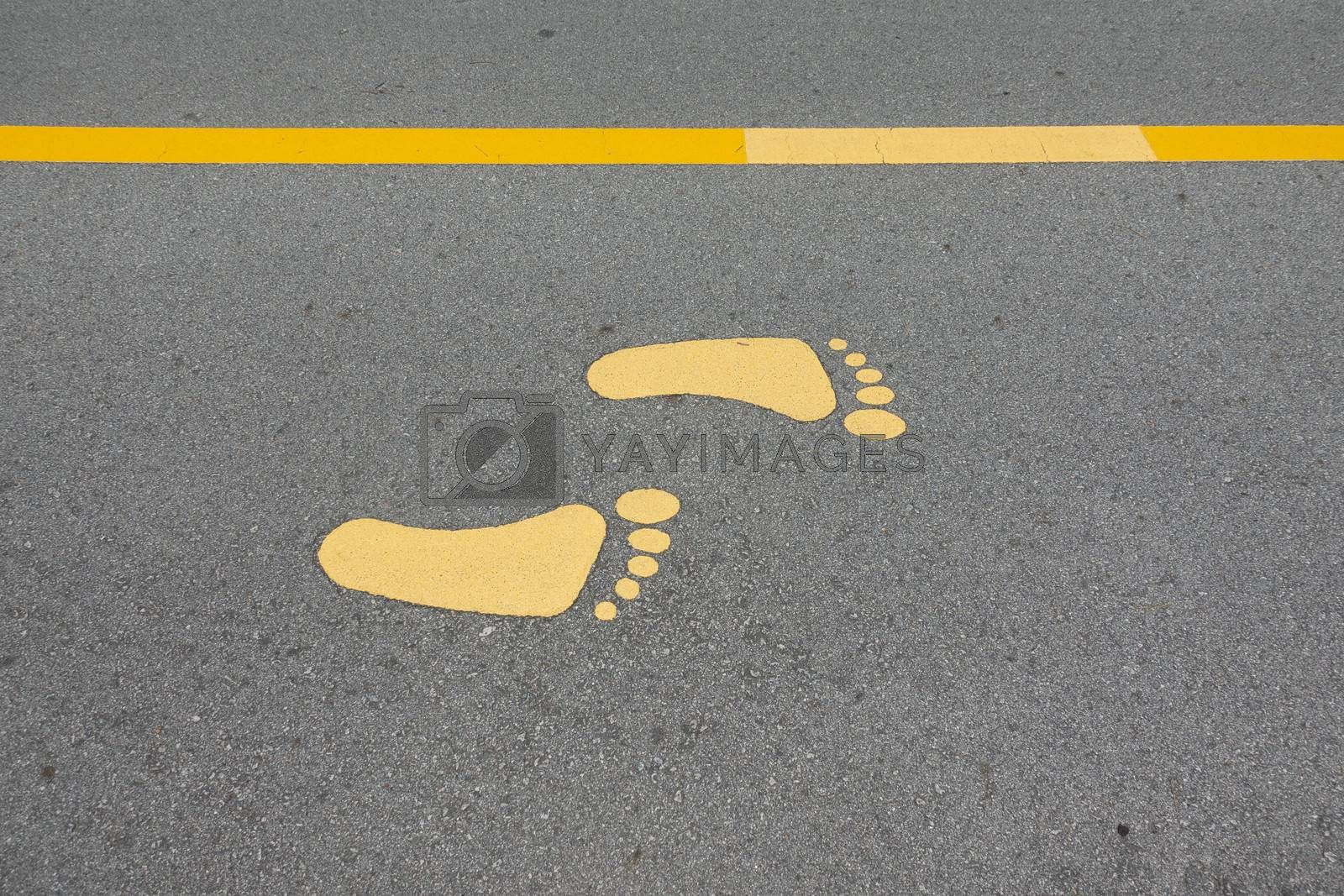 Yellow foot symbol for walk path on road