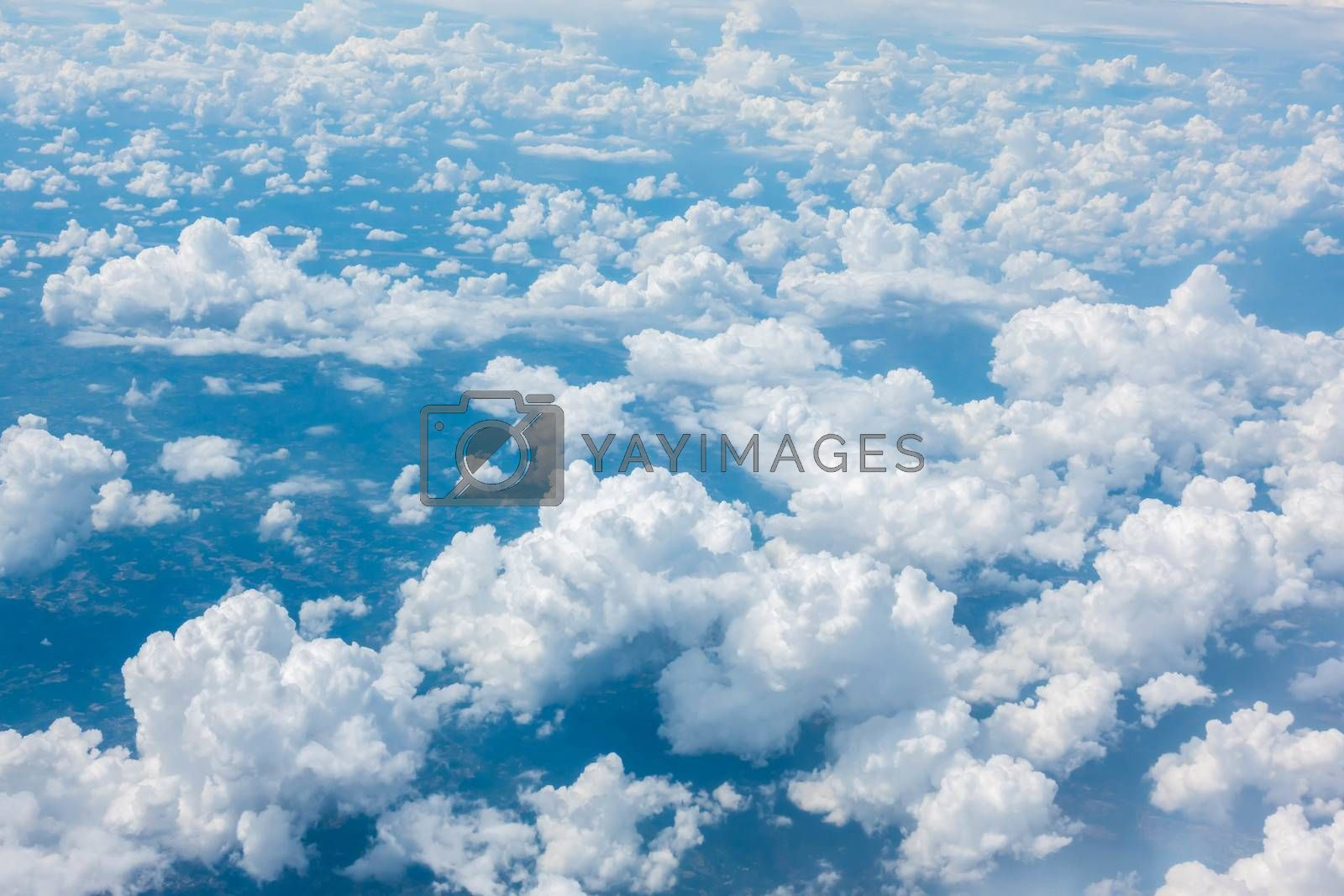 Blue sky with cloud from airplane window