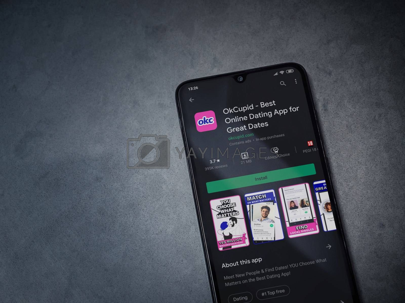 OkCupid app play store page on the display of a black mobile sma by Wave Movies