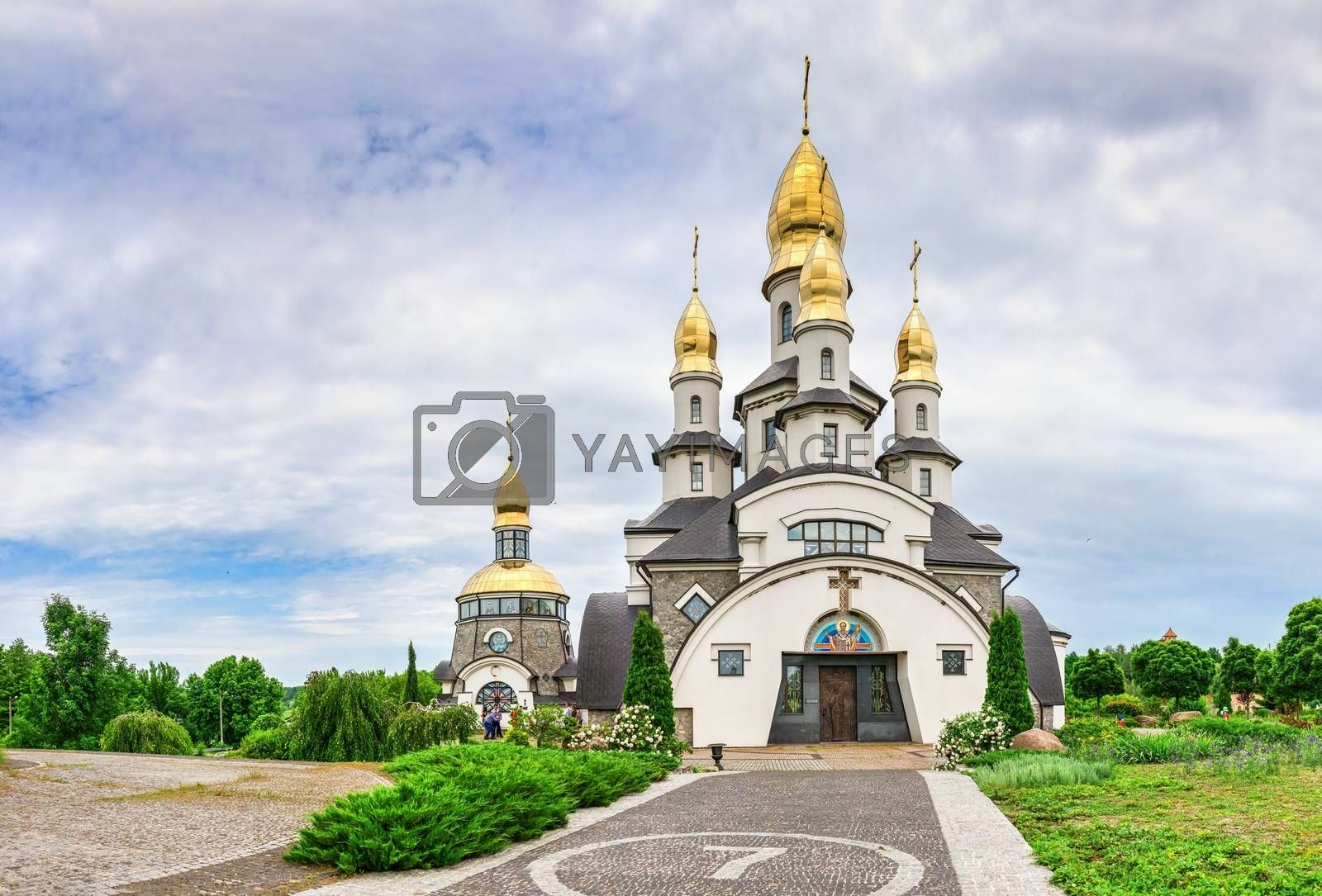 Buki, Ukraine 06.20.2020. Temple Complex with landscape Park in Buki, Ukraine, on a cloudy summer day